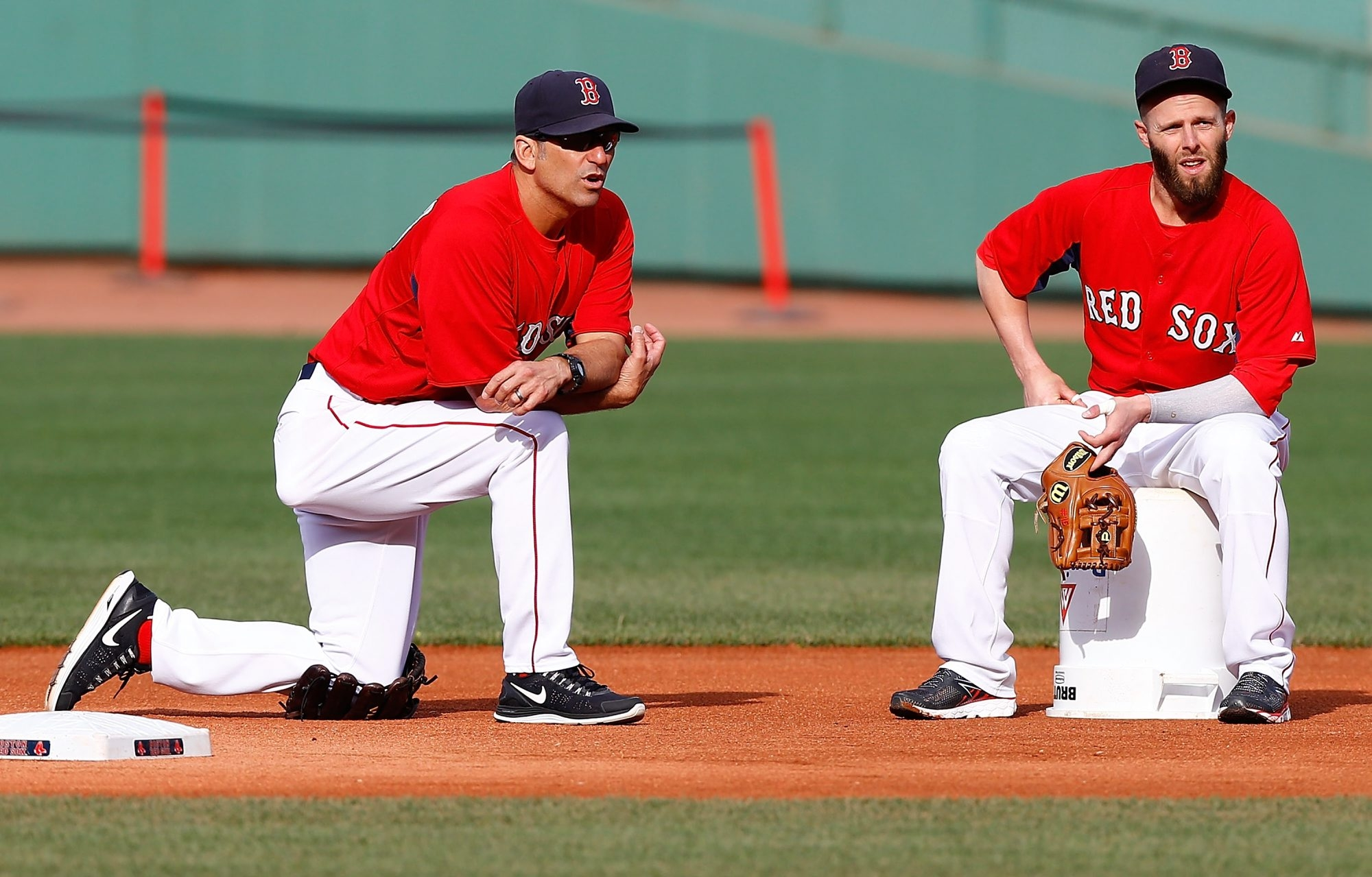Torey Lovullo, left, chats with Red Sox second baseman Dustin Petroia. Lovullo's name has come up as a candidate for several managerial positions in other major league cities.