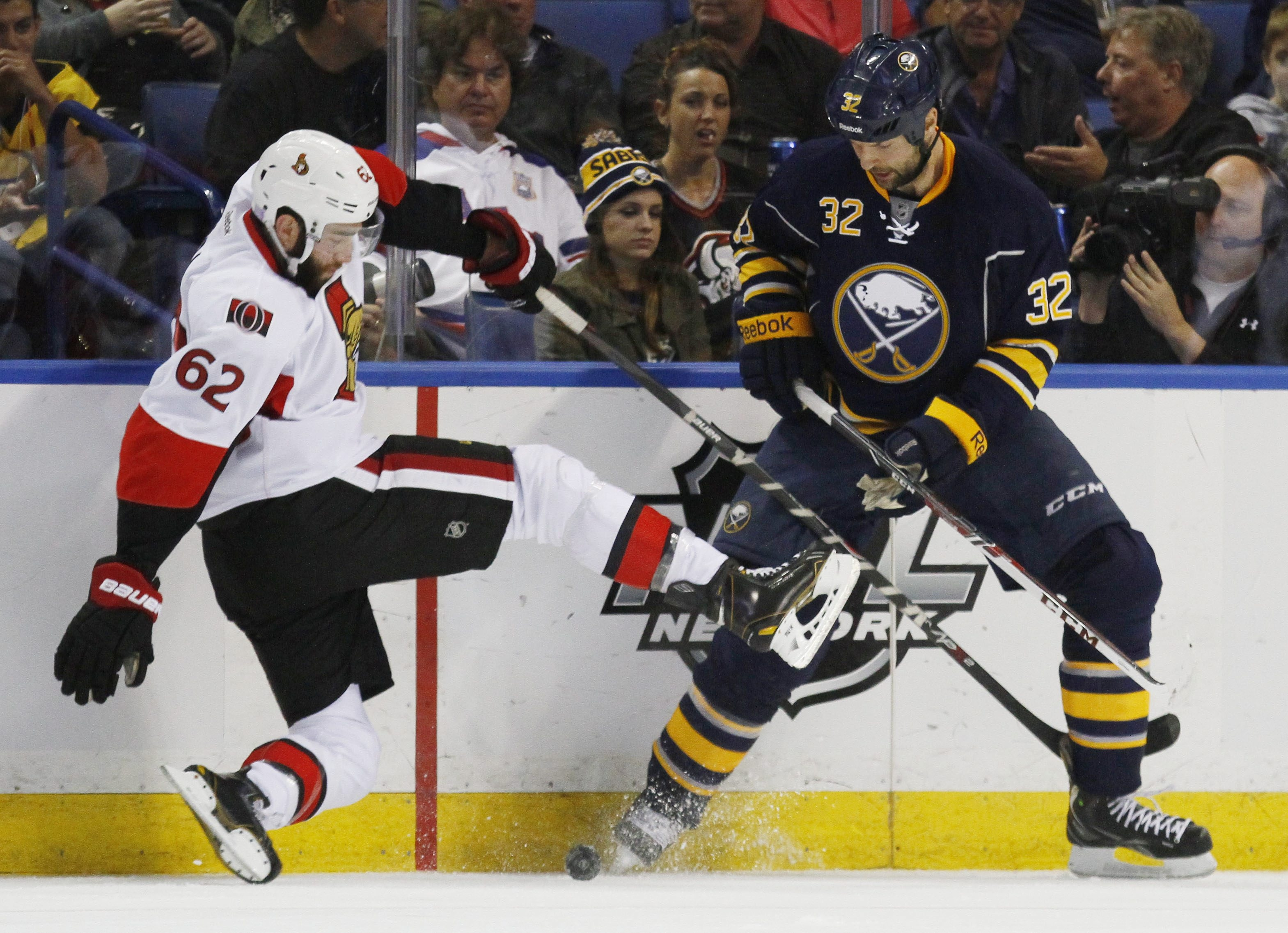Sabres' John Scott, here checking Ottawa's Eric Gryba, has seen his play come under increased scrutiny in recent days.