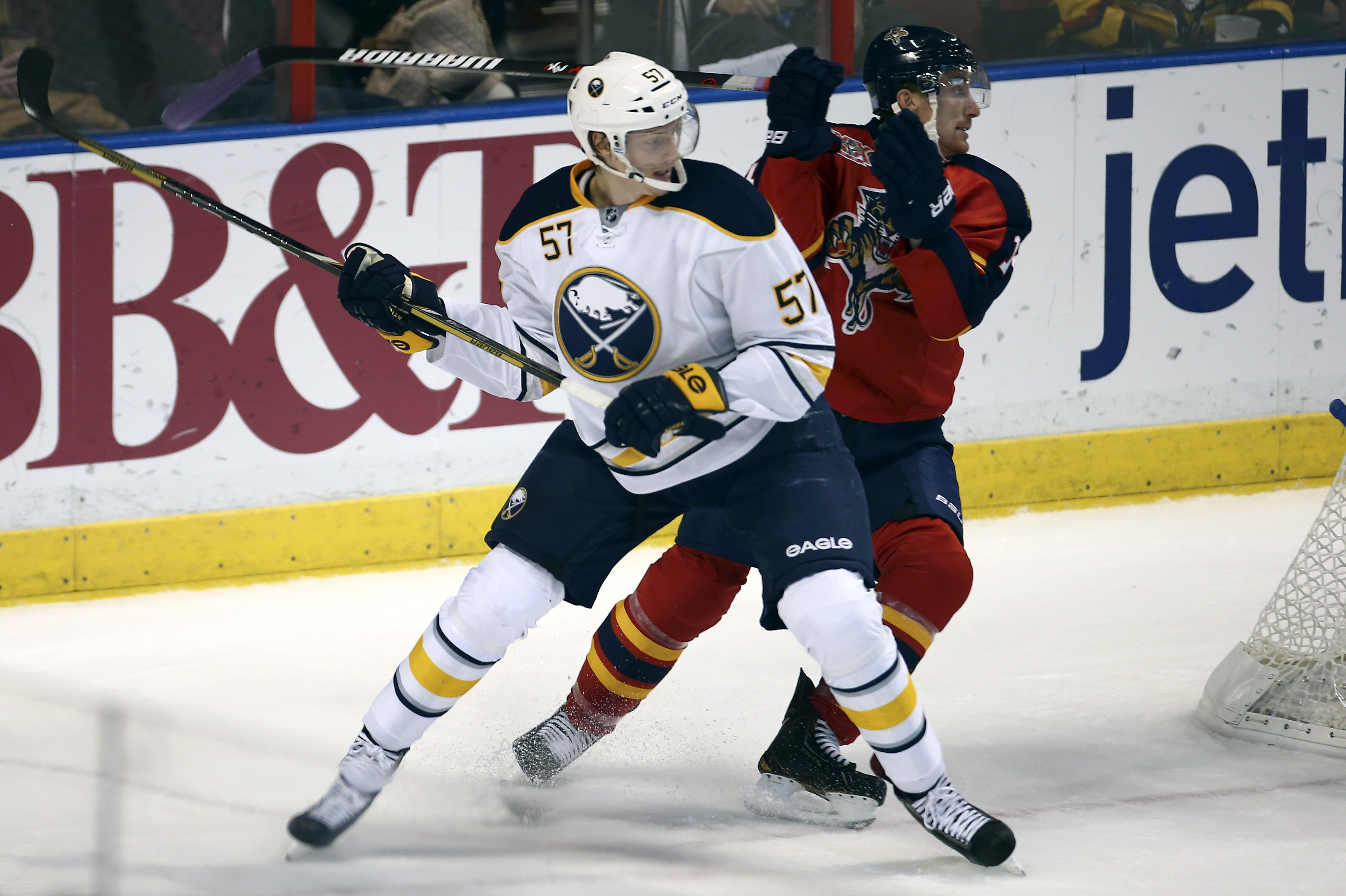 Buffalo Sabres defenseman Tyler Myers and Florida Panthers forward Tomas Fleischmann chase the puck during the first period. (AP Photo/J Pat Carter)