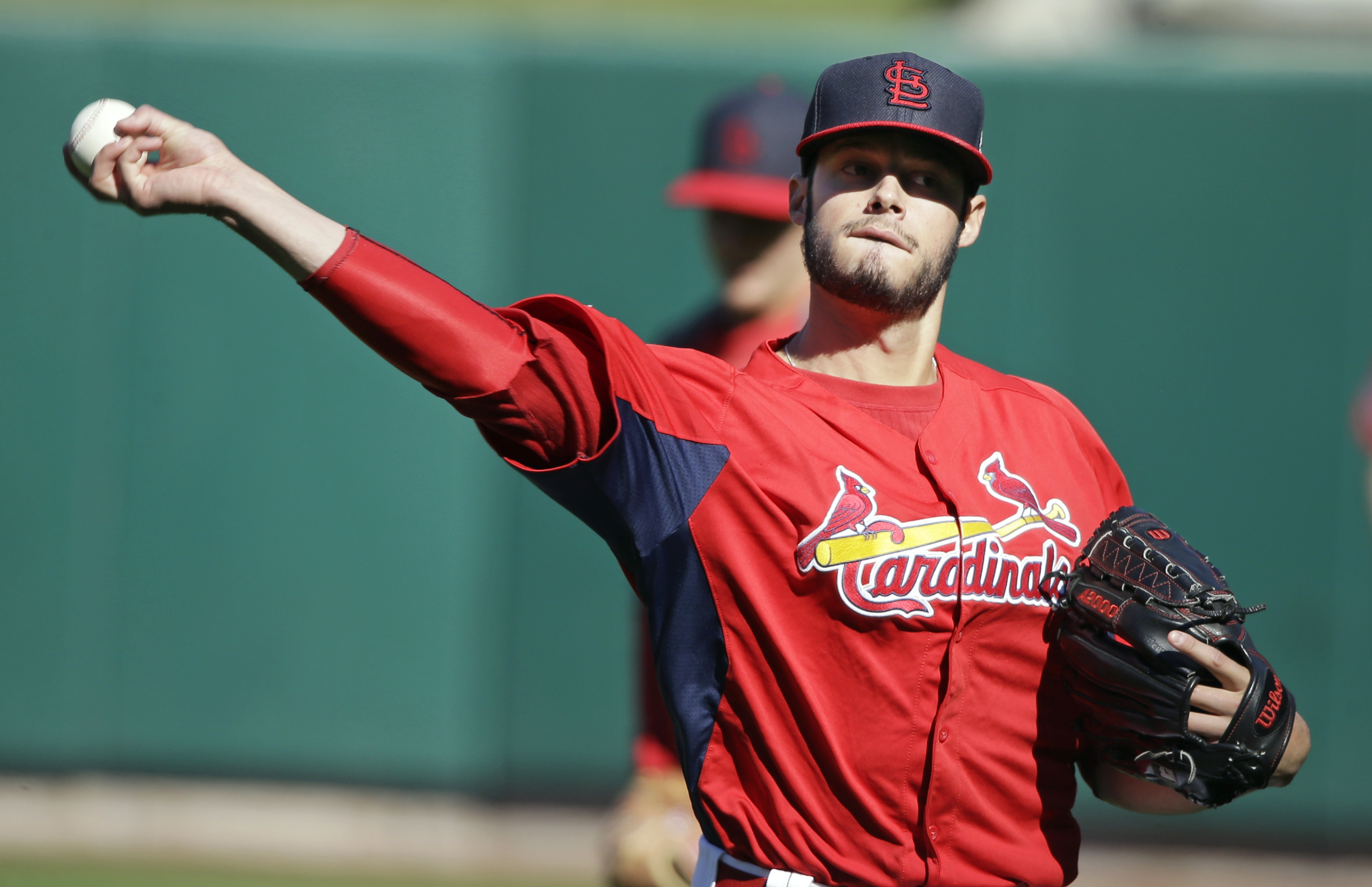 St. Louis Cardinals Game Three starter Joe Kelly warms up during practice Friday at Busch Stadium.