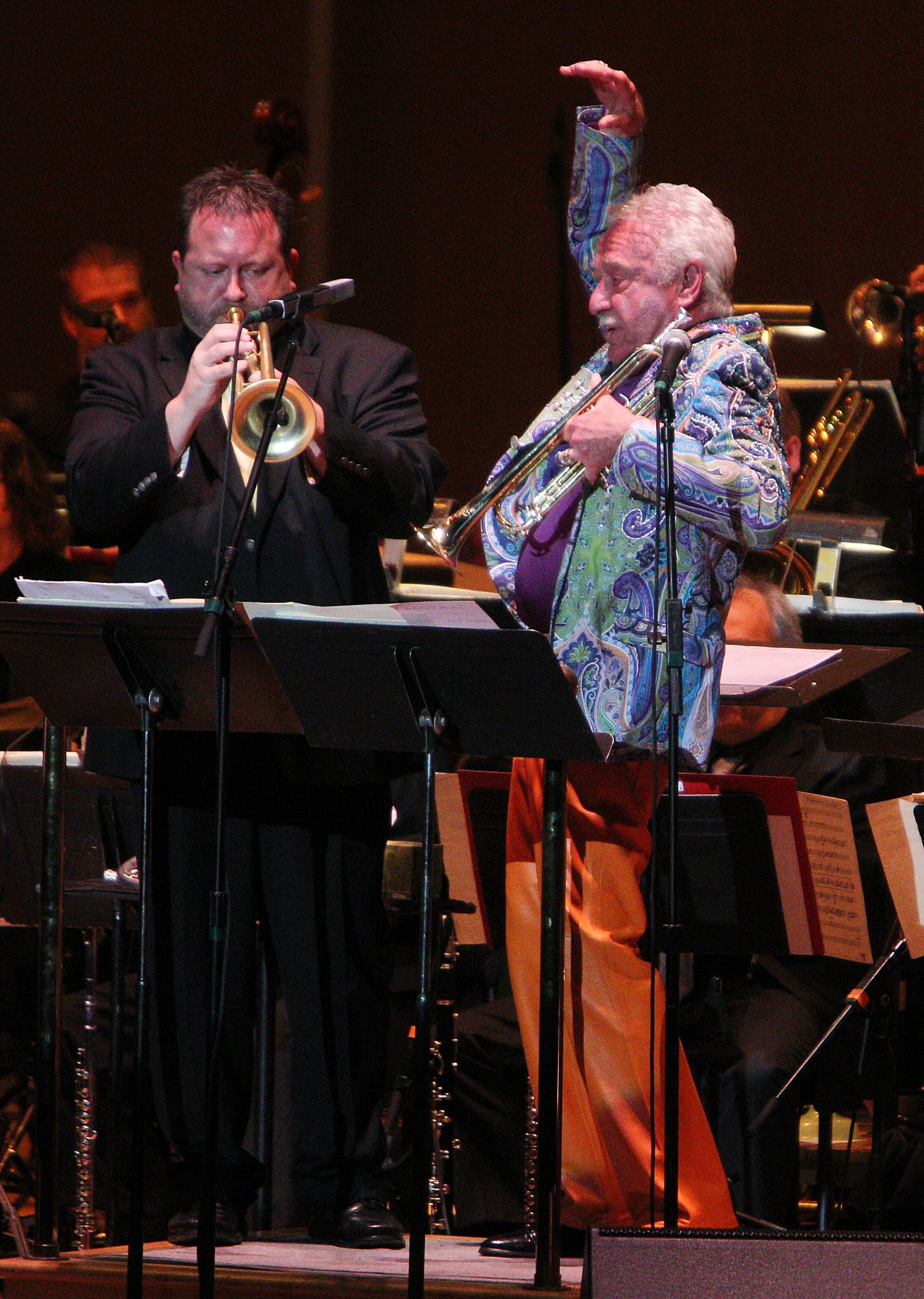"""Doc Severinsen conducted and played trumpet in the first of three BPO concerts at Kleinhans Music Hall in Buffalo, Friday, Oct. 25, 2013. Here, he plays trumpet for a Tommy Dorsey song """"Well, Git It!""""  He's accompanied on trumpet by Brad Shermock from his big band.  (Sharon Cantillon/Buffalo News)"""