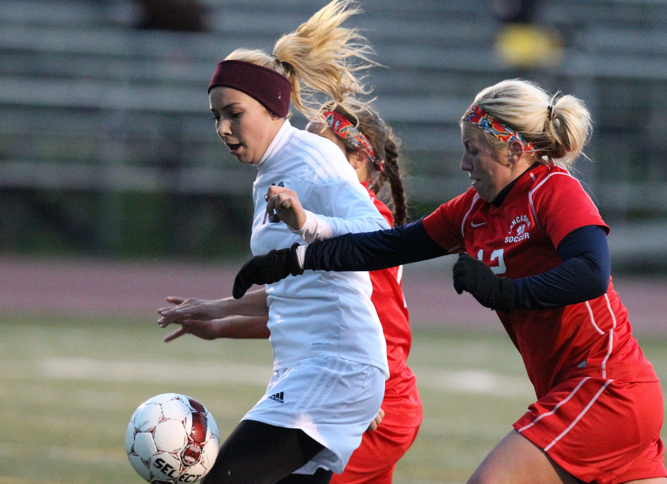 Orchard Park's Sarah Gaczewski battles Lancaster's Danielle Zale for the ball in the first half of the Quakers' 4-0 win.