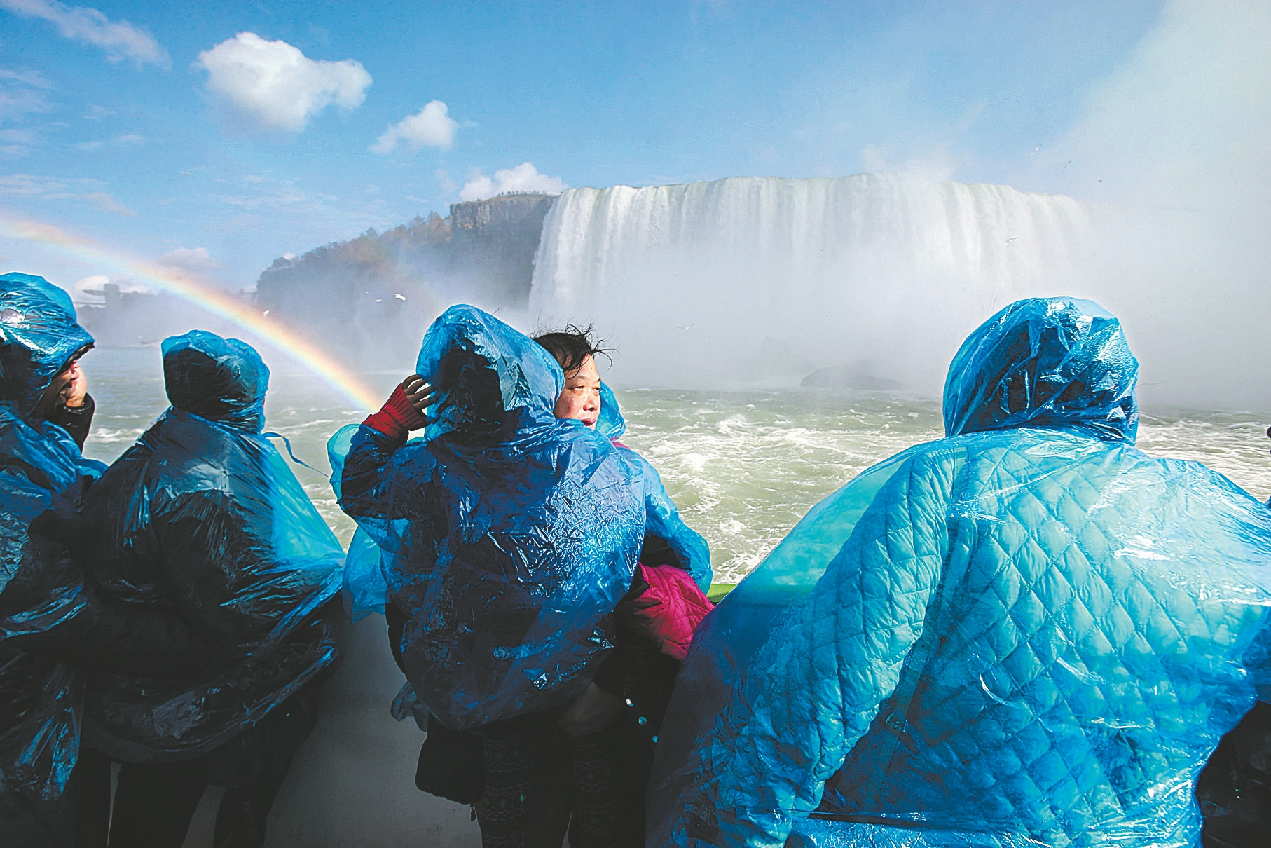 Passengers look at a rainbow over the American Falls from the Maid of the Mist on the next-to-last day of operations from the Canadian side of the river on Wednesday.