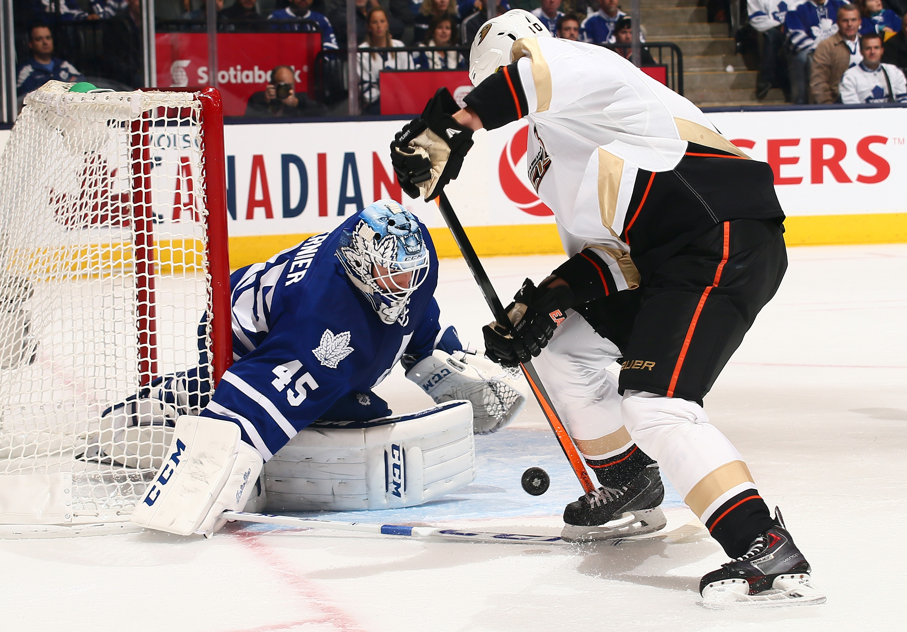 TORONTO, ON – OCTOBER 22: Jonathan Bernier #45 of the Toronto Maple Leafs stops Corey Perry #10 of the Anaheim Ducks during NHL action at the Air Canada Centre October 22, 2013 in Toronto, Ontario, Canada.  (Photo by Abelimages/Getty Images)