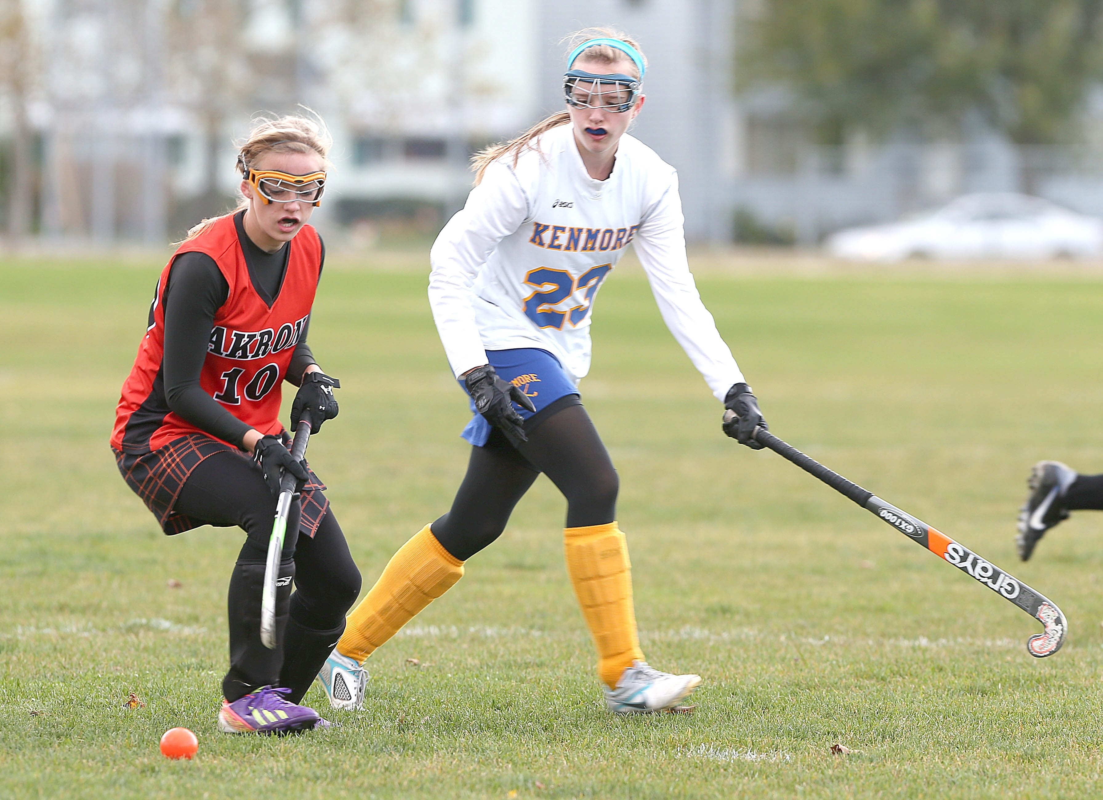 Kenmore's Kaitlyn Burke defends against Akron's Loriann Blenker during Tuesday's field hockey showdown. The teams played to a 1-1 tie.