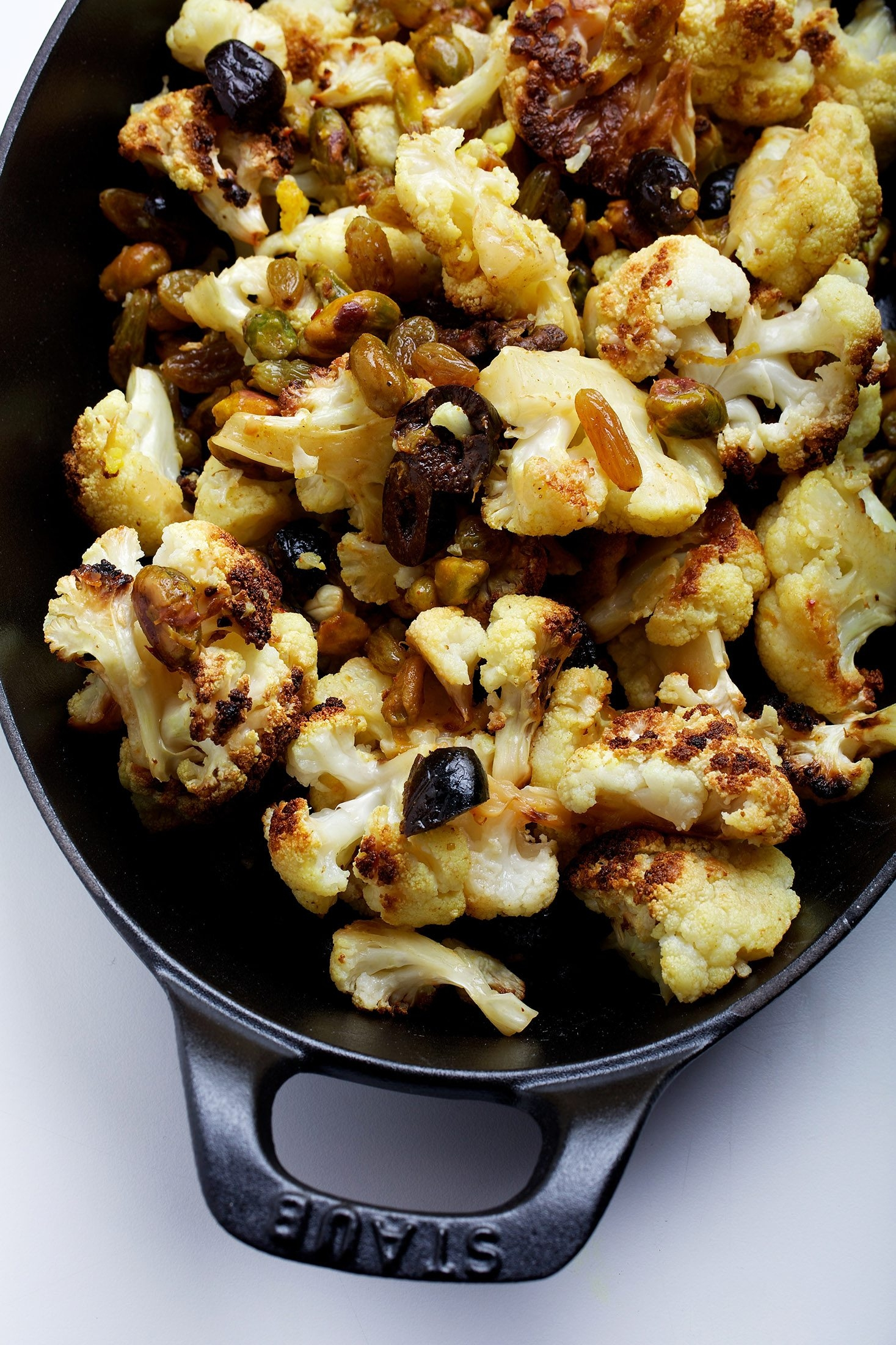 Cauliflower is a visibly alluring vegetable, as  in this Roasted Cauliflower with Pistachios, Olives and Raisins dish. See recipe below.