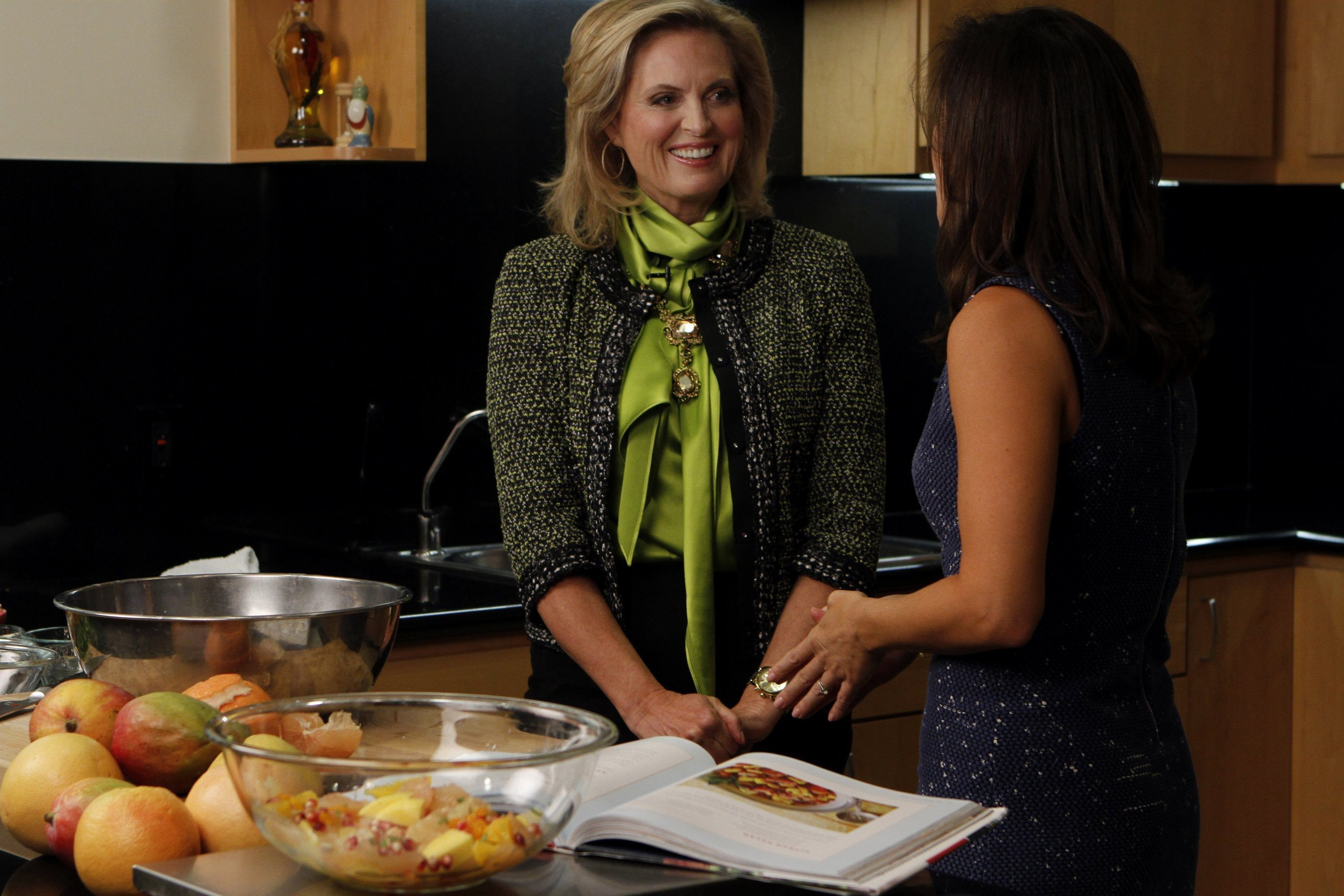 Ann Romney, left, demonstrates recipes for her citrus salad as she talks with Los Angeles Times reporter Maeve Reston, right, in the newspaper's test kitchen.