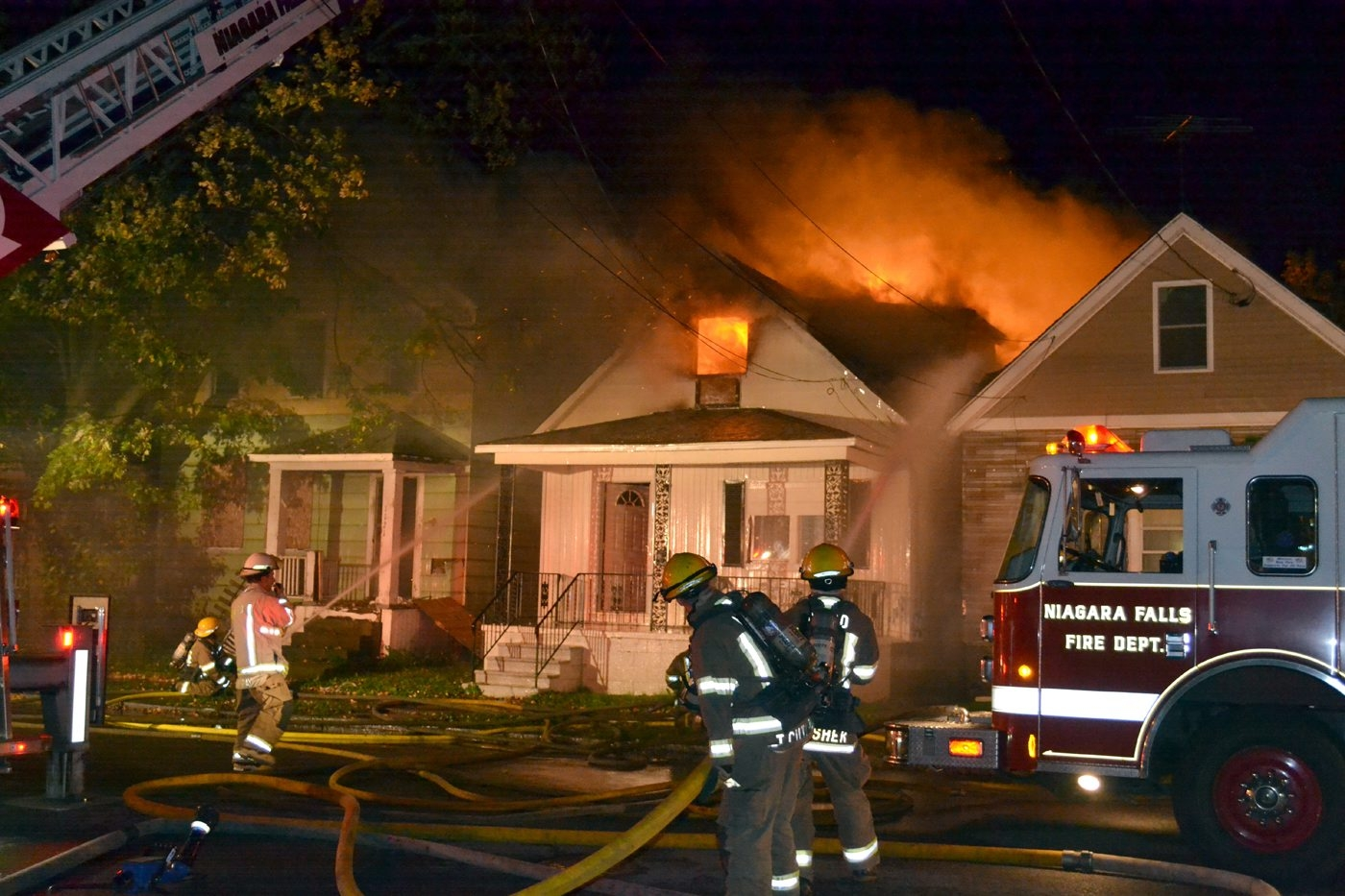 Niagara Falls firefighters battle a blaze at 1119 Pierce Ave. early today.