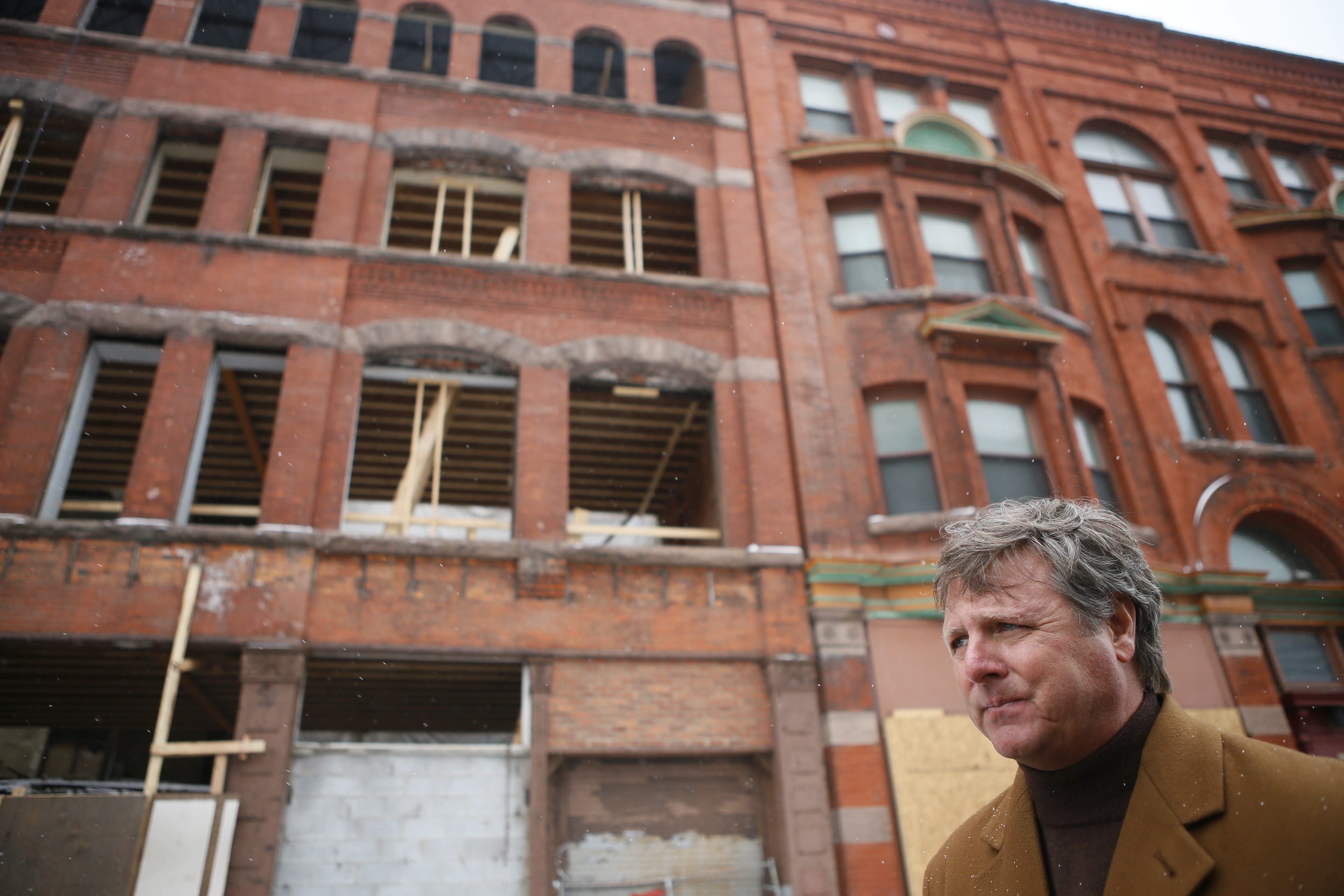 James Swiezy, president of Greenleaf & Co., has incentives to proceed on plan to turn 122-year-old Bosche Building at 916-918 Main St. into 23 market-rate apartments across from Medical Campus.