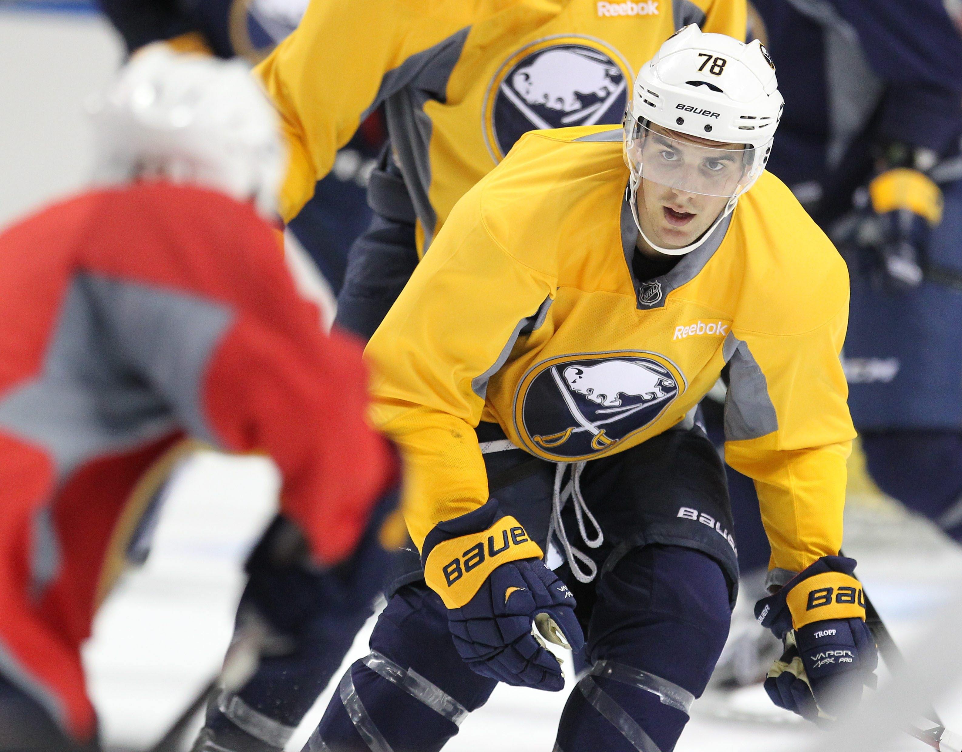 Corey Tropp practiced Monday with the Sabres but he hasn't been cleared for contact and is weeks from playing.