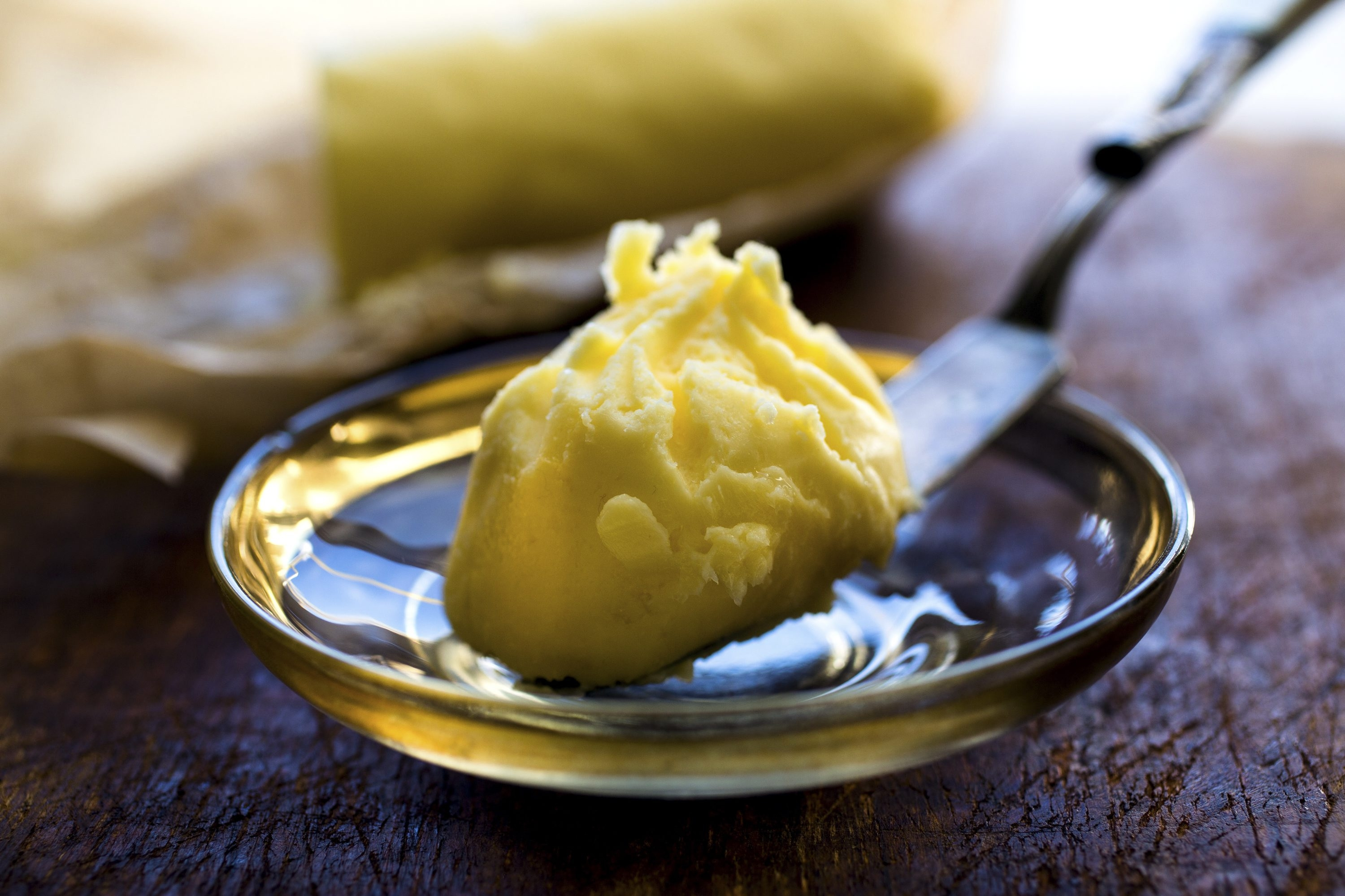 A scoop of homemade cultured butter, ultra-creamy and nutty flavored.