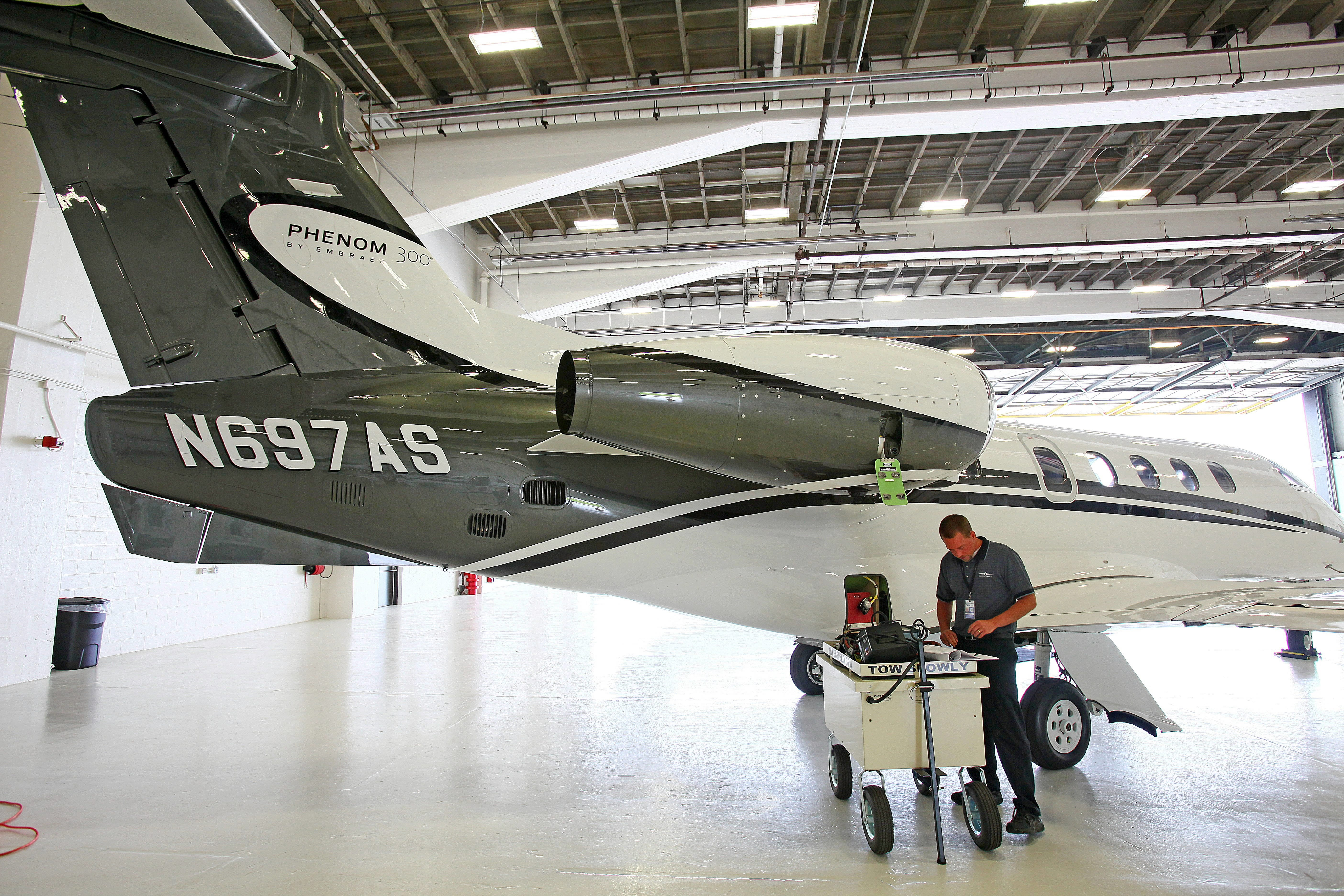 A maintenance technician does a daily routine check up on a jet at the Executive AirShare hangar The company just signed a 10-year lease at the Buffalo Niagara International Airport.   {Robert Kirkham / Buffalo News file photo}