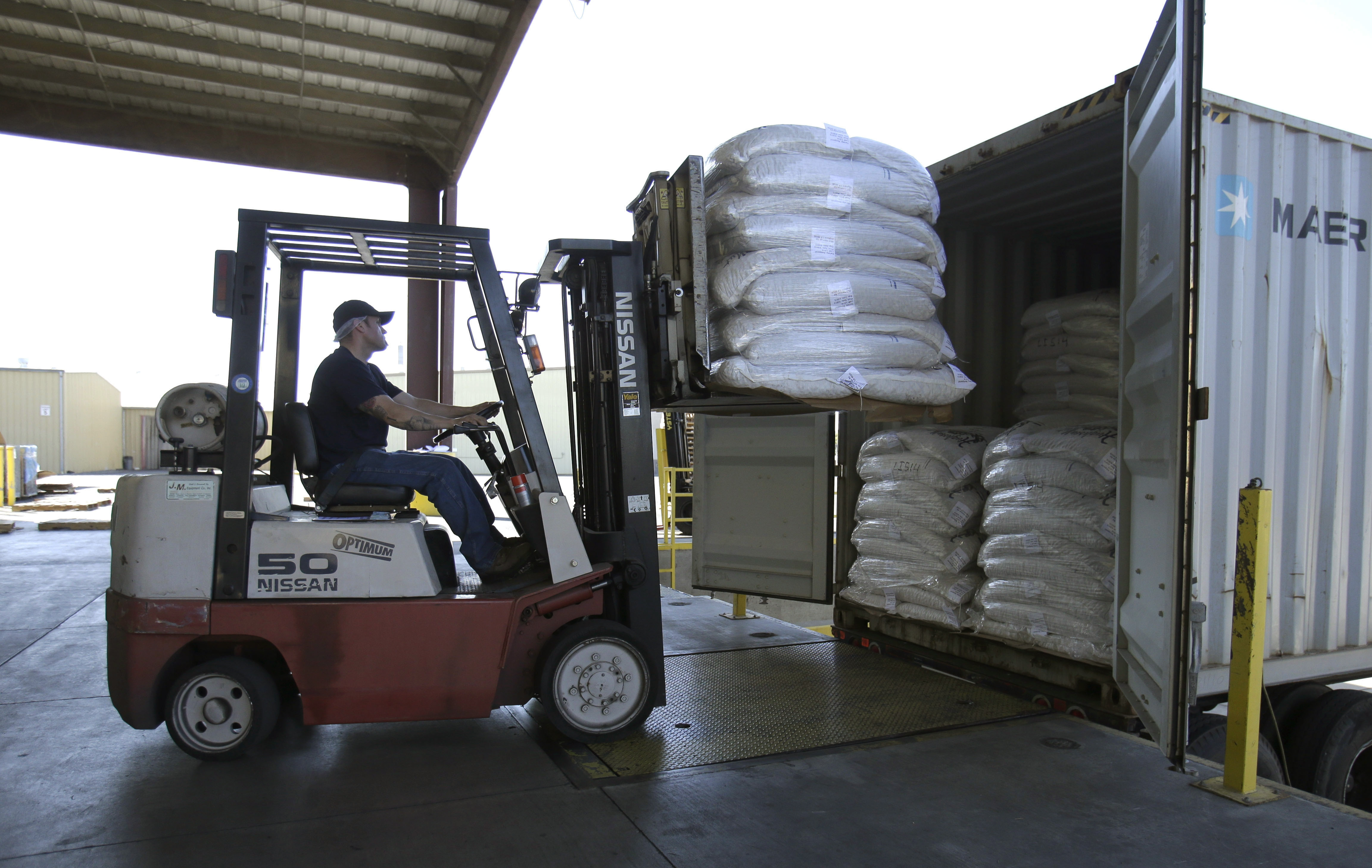 Bags of almonds are loaded into a truck at Hughson Nut, Inc., in Livingston, Calif. Hughson has been a victim of con men posing as truckers in order to steal freight.