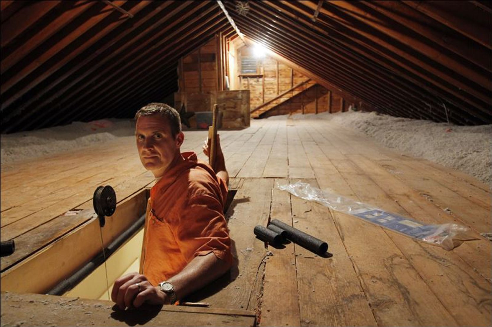 Installing insulation to the attic as an energy-saving measure may qualify for a tax credit this year.