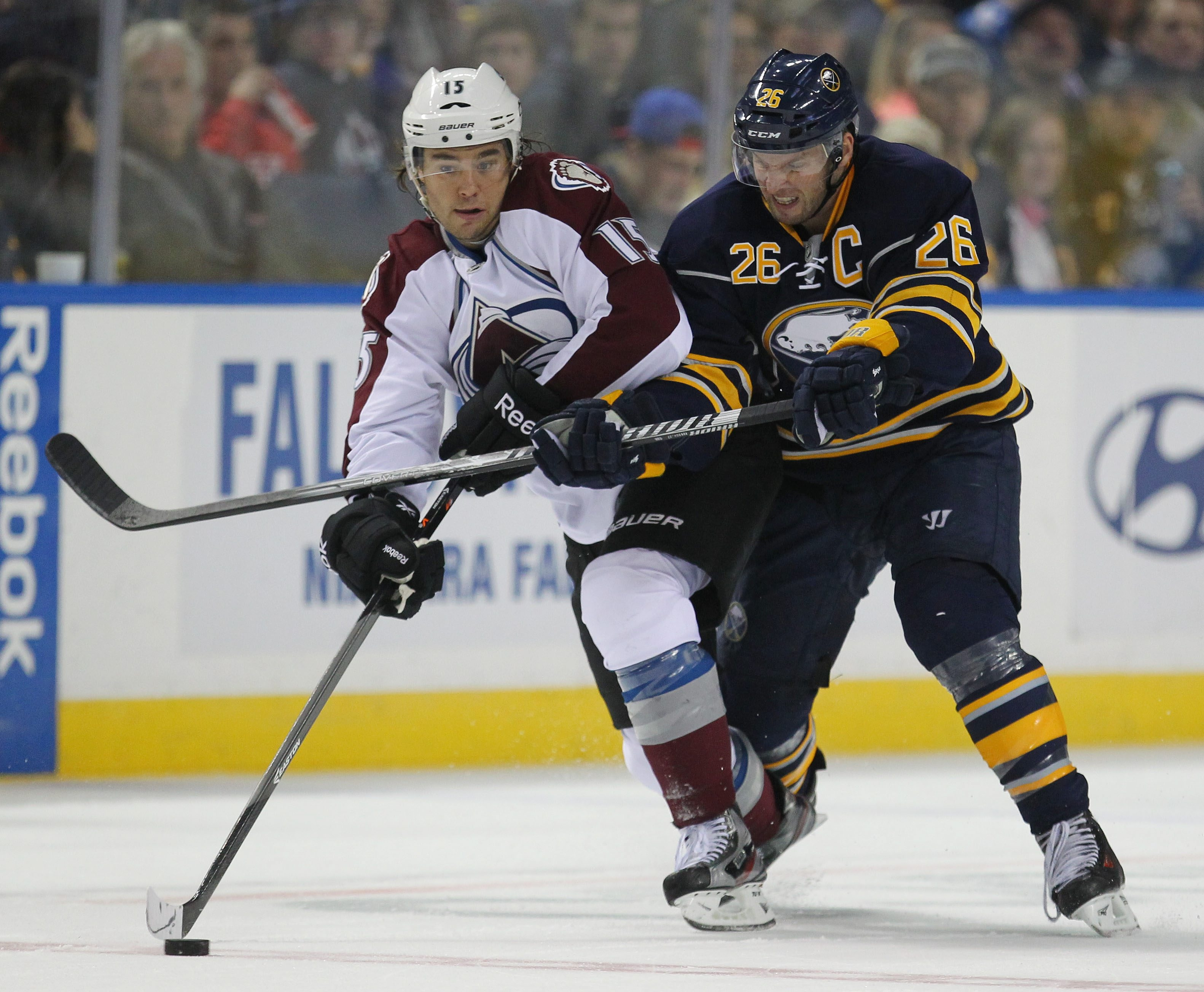 The Sabres' Thomas Vanek tries to knock Colorado's P.A. Parenteau off the puck during the second period at the First Niagara Center.