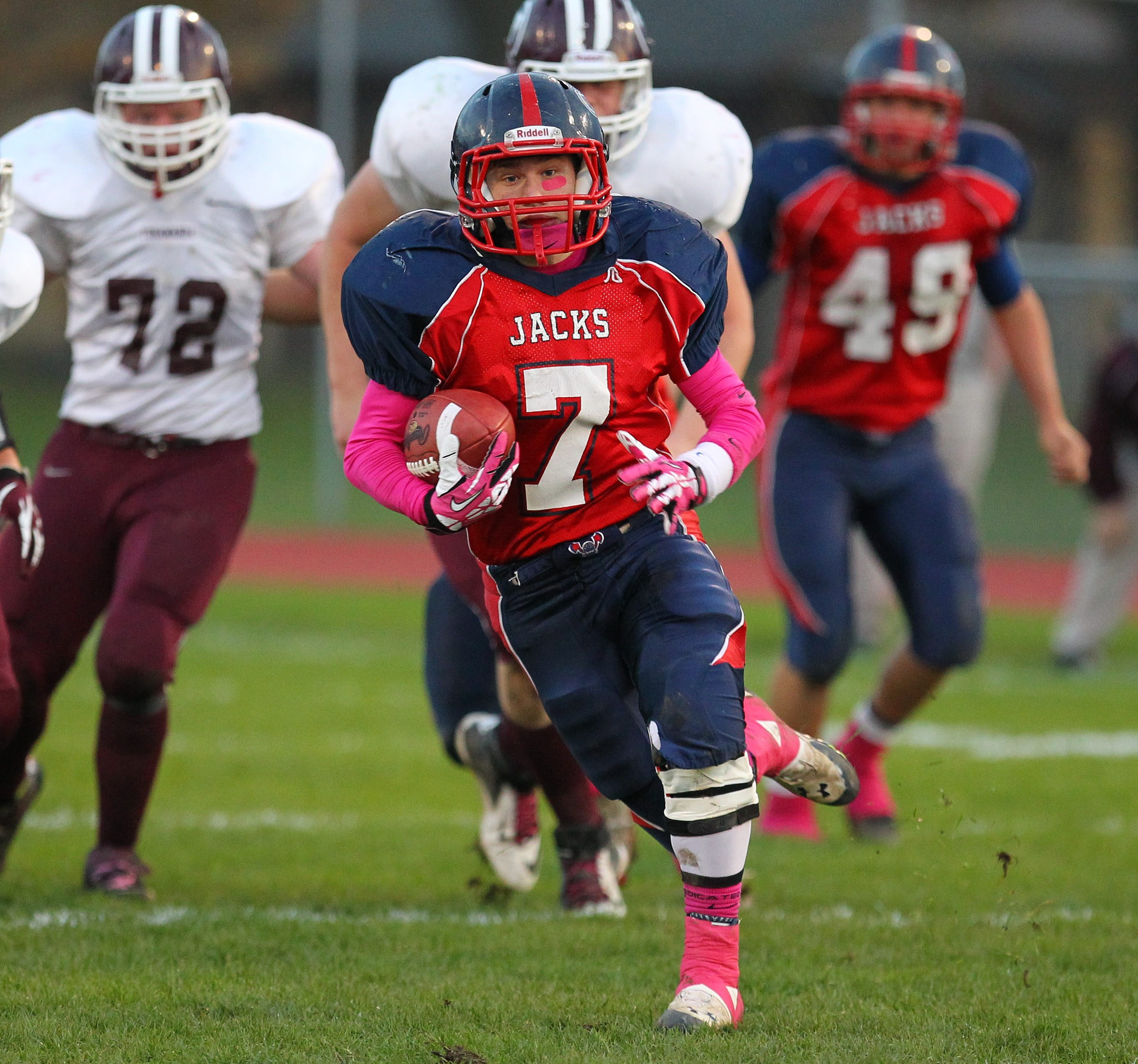 North Tonawanda's Nehemiah Stone dashes for a chunk of his 161 yards of offense. Stone also scored three touchdowns.  N