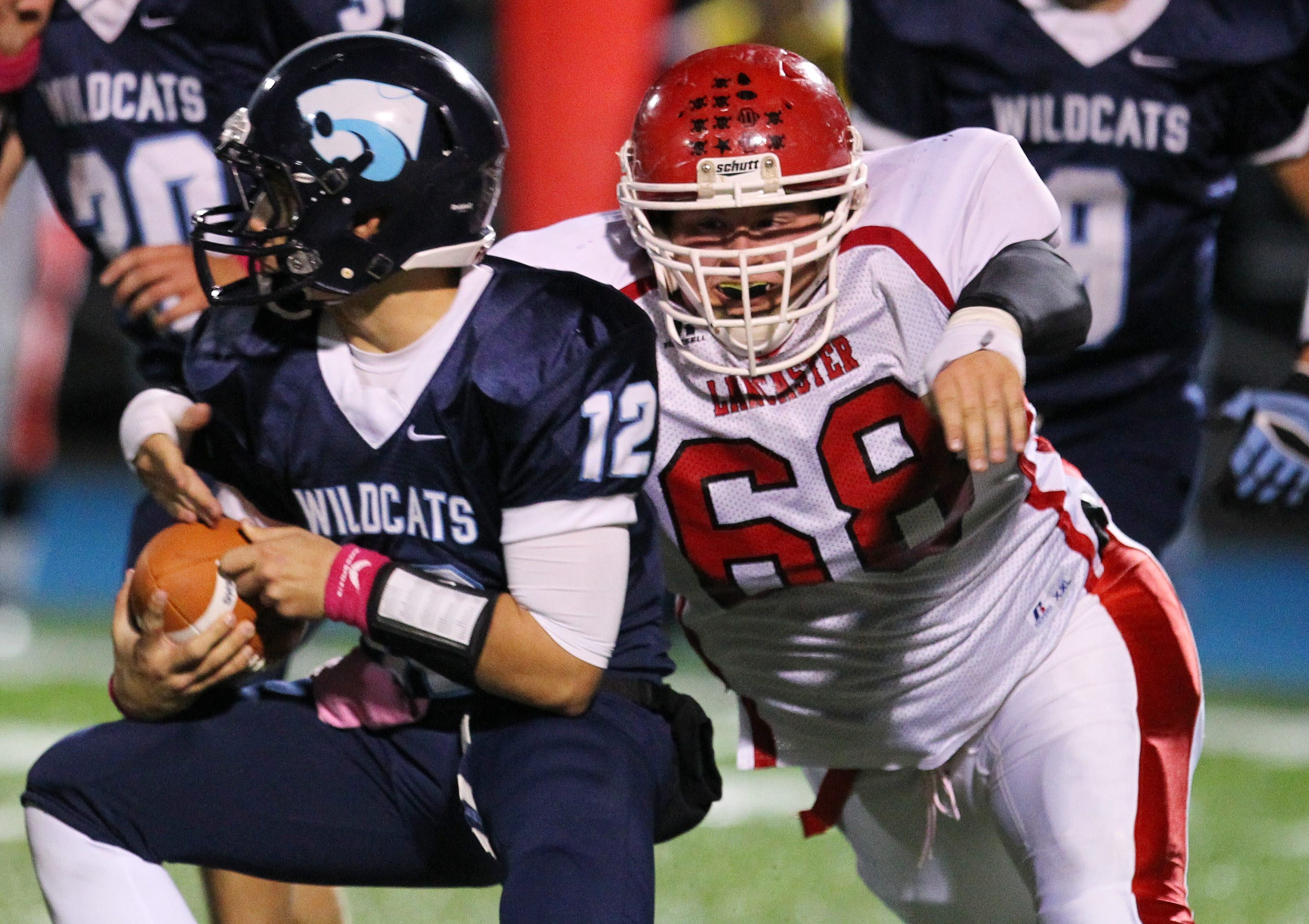 Lancaster's Zack Szarpa moves in to tackle Dylan Sekuterski of Depew during the first half. Lancaster beat its rival, 36-0, in the game at Depew.