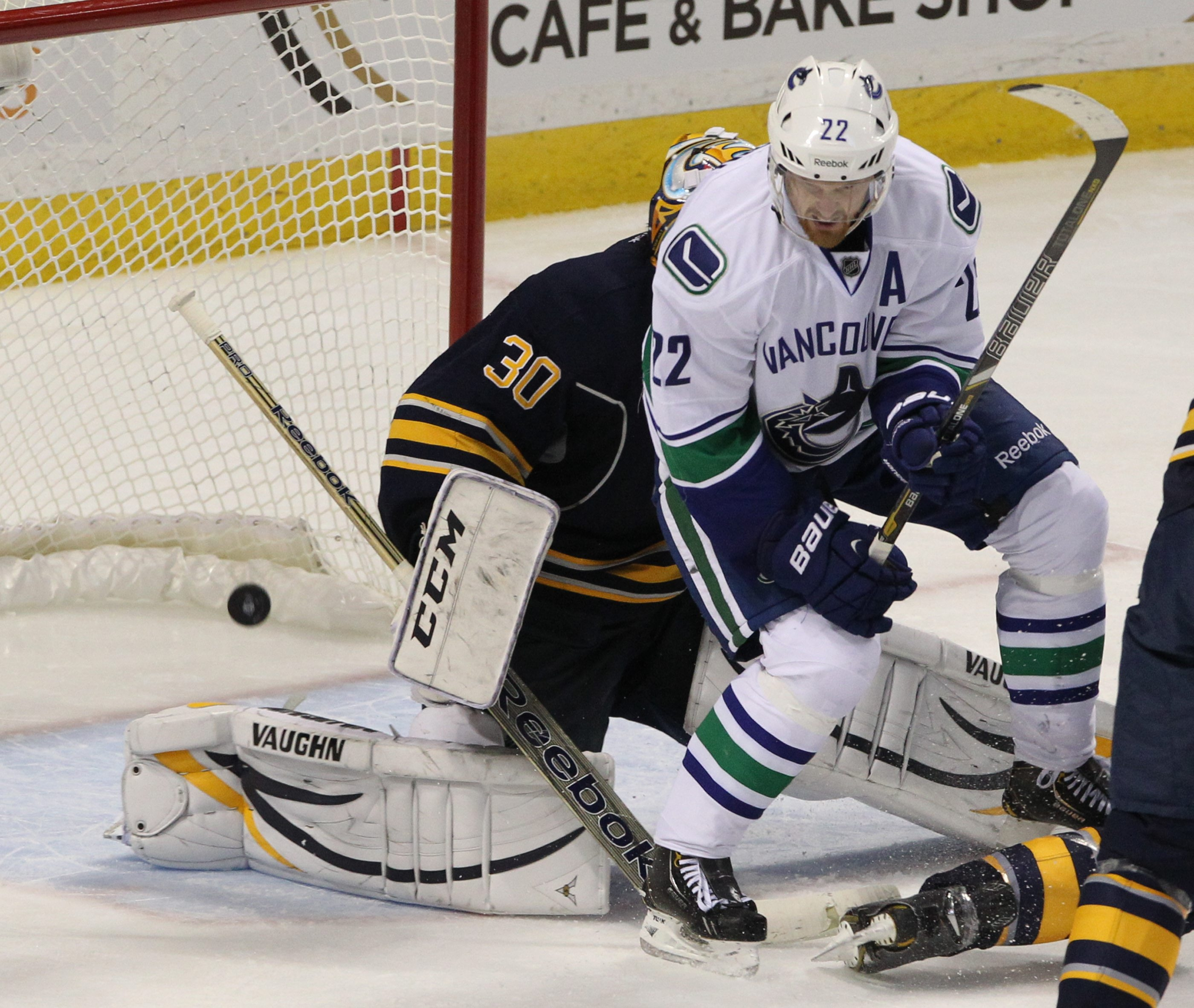 Canucks left wing Daniel Sedin (22) screens Sabres goalie Ryan Miller on Ryan Stanton's third-period goal, Vancouver's third of the game.