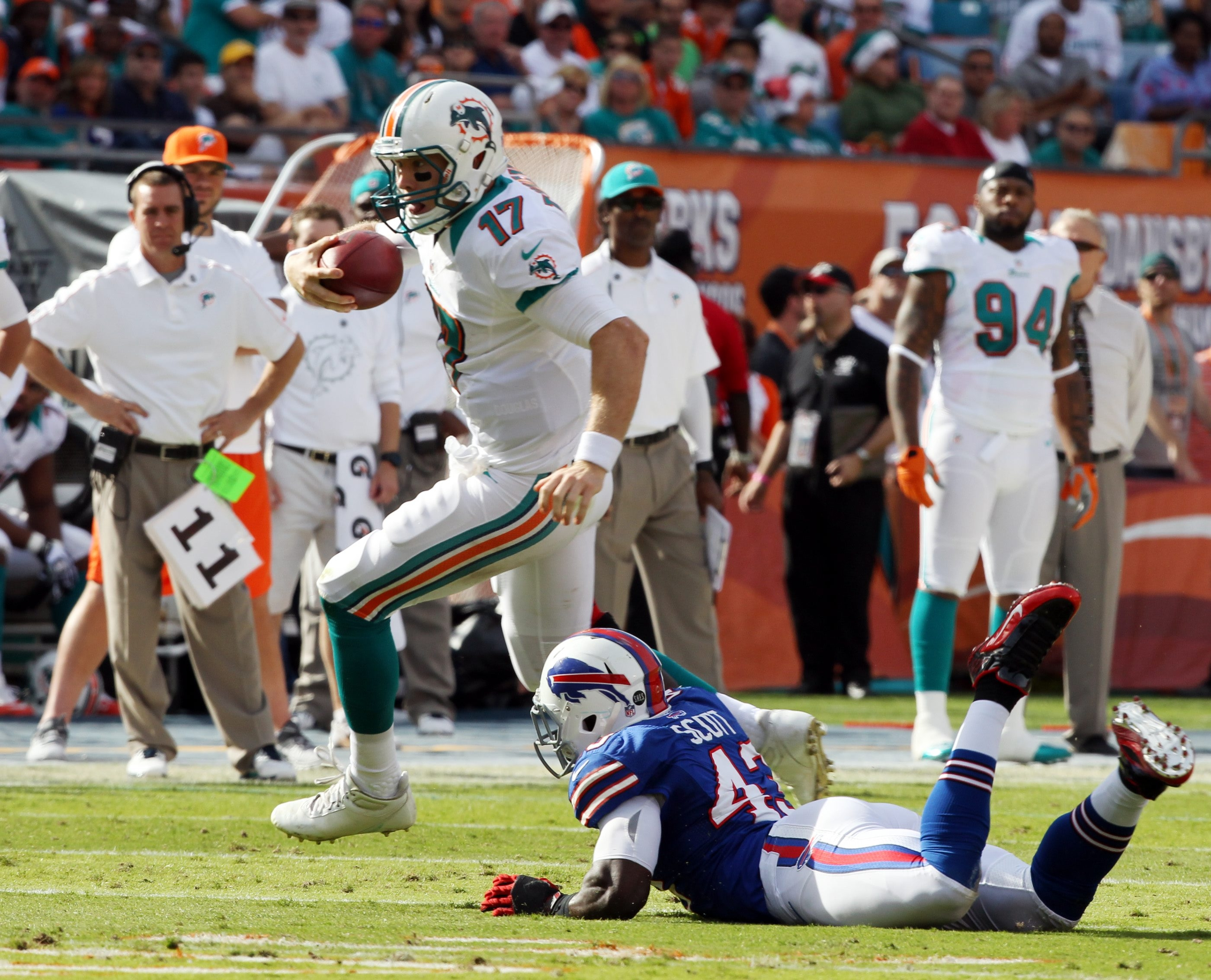 Dolphins' Ryan Tannehill gains 30 yards against the Bills last December.