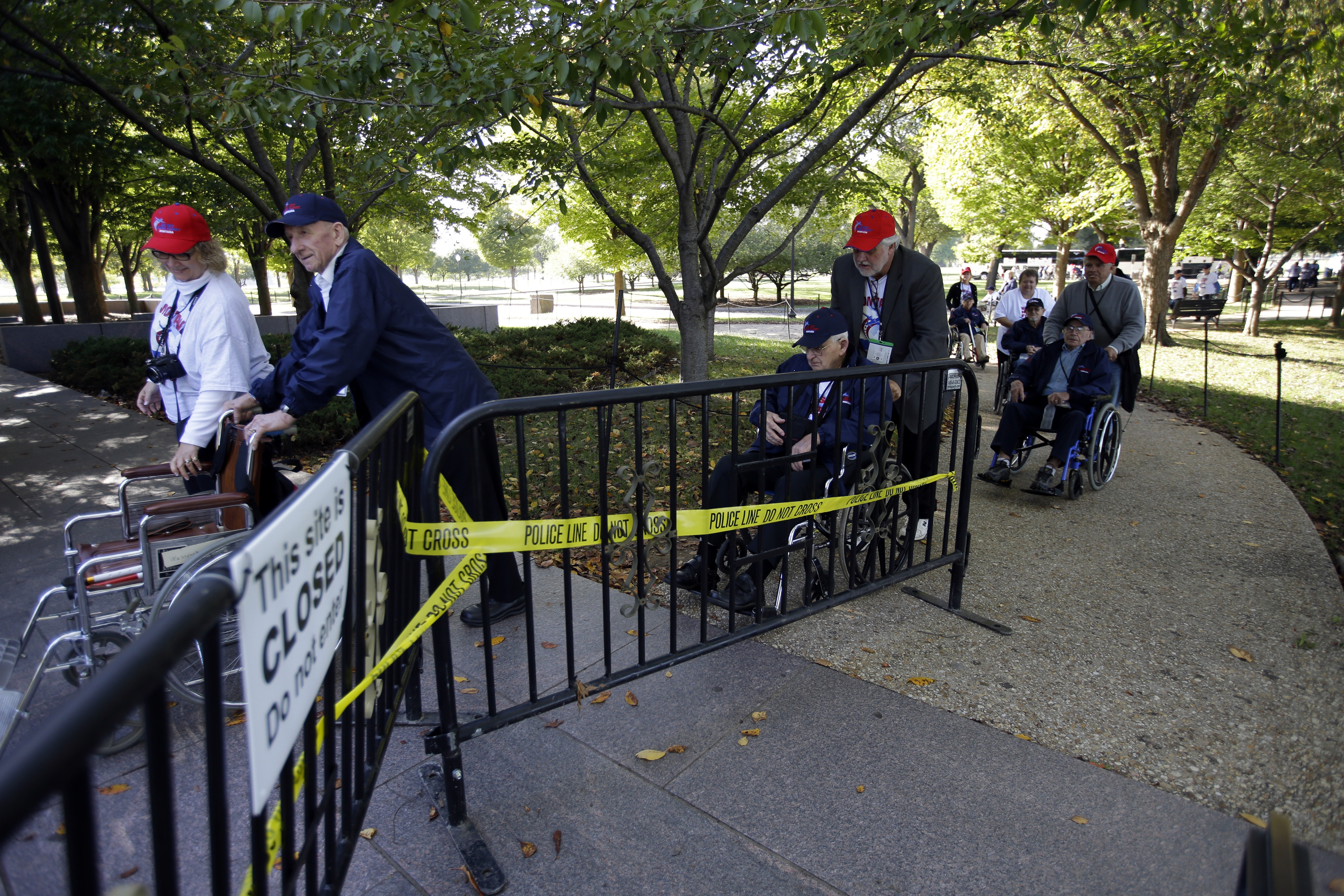 World War II veterans from Montana skirted barricades to visit the Franklin Delano Roosevelt Memorial earlier this week in Washington. Action to fund the government means the barriers will come down, at least until the money runs out in January.