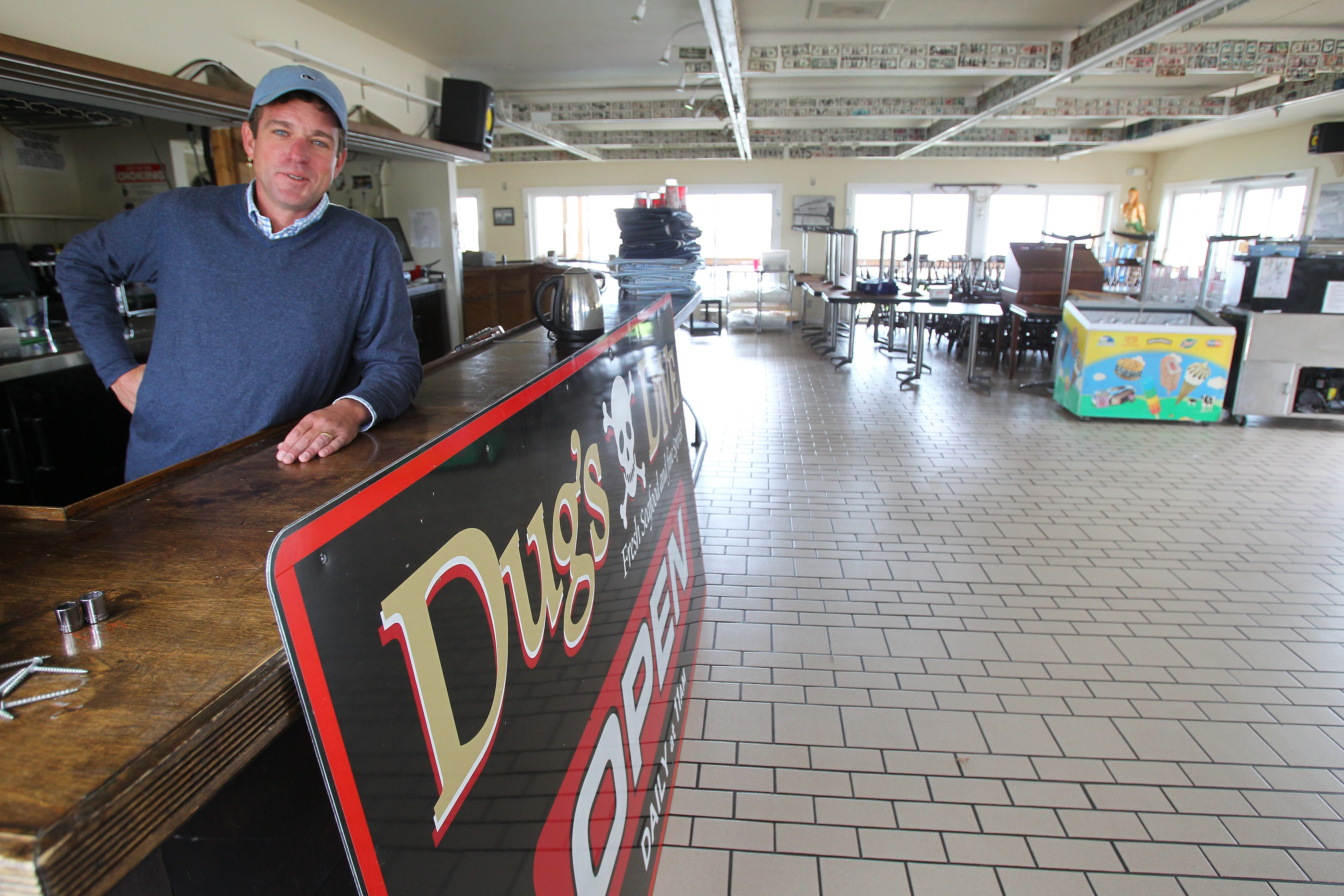 Dug's Dive owner Tucker Curtain stands at the bar of the restaurant at the Erie Basin Marina in Buffalo Thursday, October 17, 2013.  The restaurant is closed for the winter.   (Mark Mulville/Buffalo News)