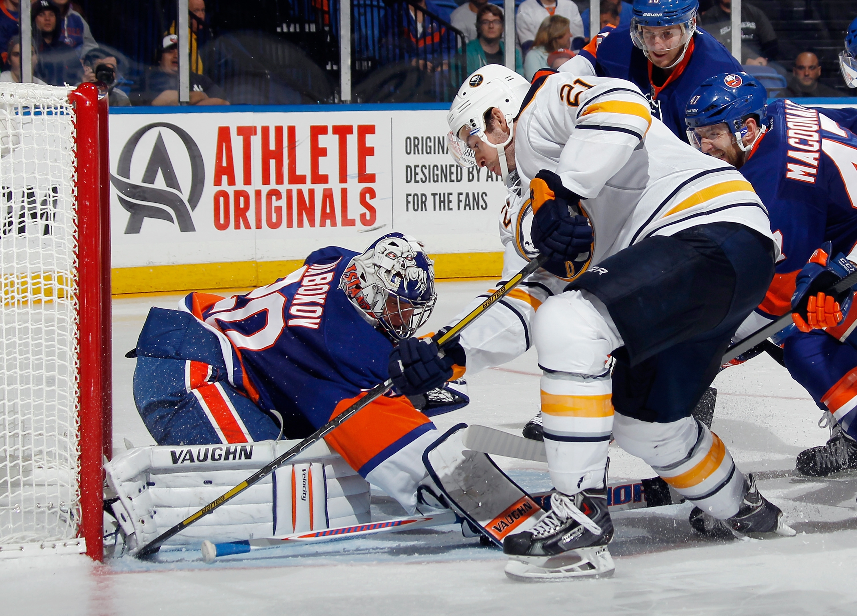 Evgeni Nabokov of the New York Islanders makes a third-period save on Drew Stafford, who went around the defense and took the puck to the net.