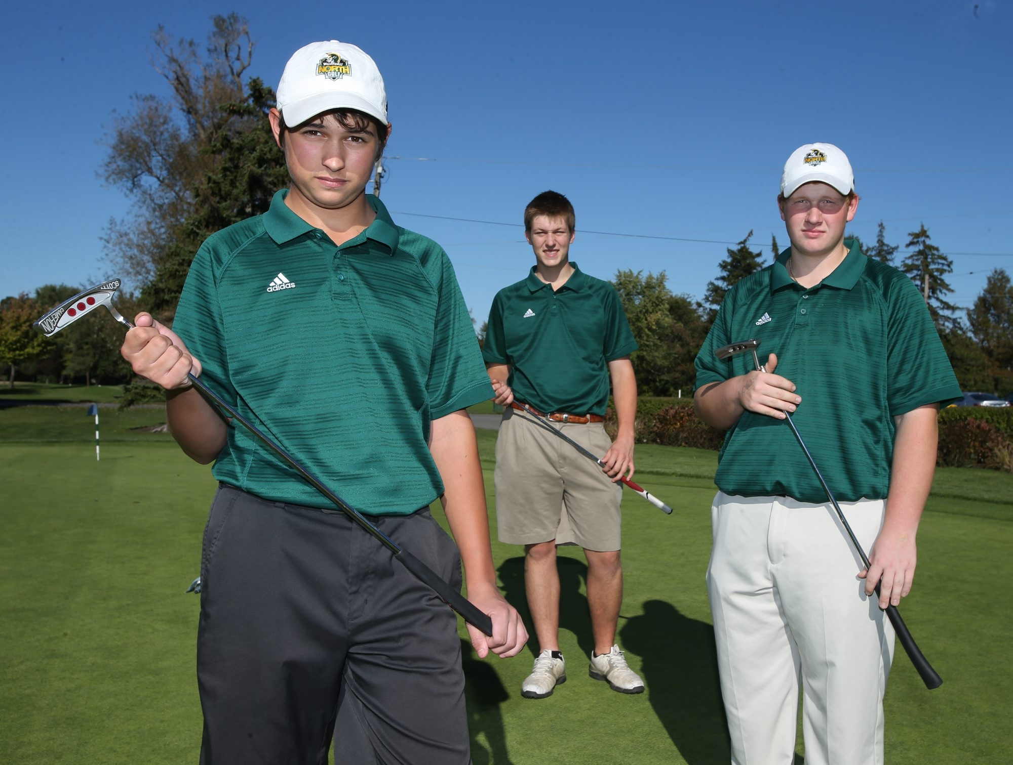 Williamsville North's Ben Reichert, Tim Kreuz and Matt Lesinski are part of a dominant Spartan squad that is among the favorites to win today's ECIC Championships at Diamond Hawk.