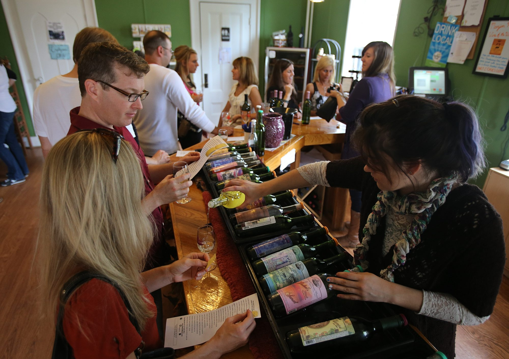 People crowd around the tasting bar on a recent weekend at The Winery at Marjim Manor in Appleton, one of 19 members of the Niagara Wine Trail. A new law provides for the trail to be split between Ridge and Lake sections.