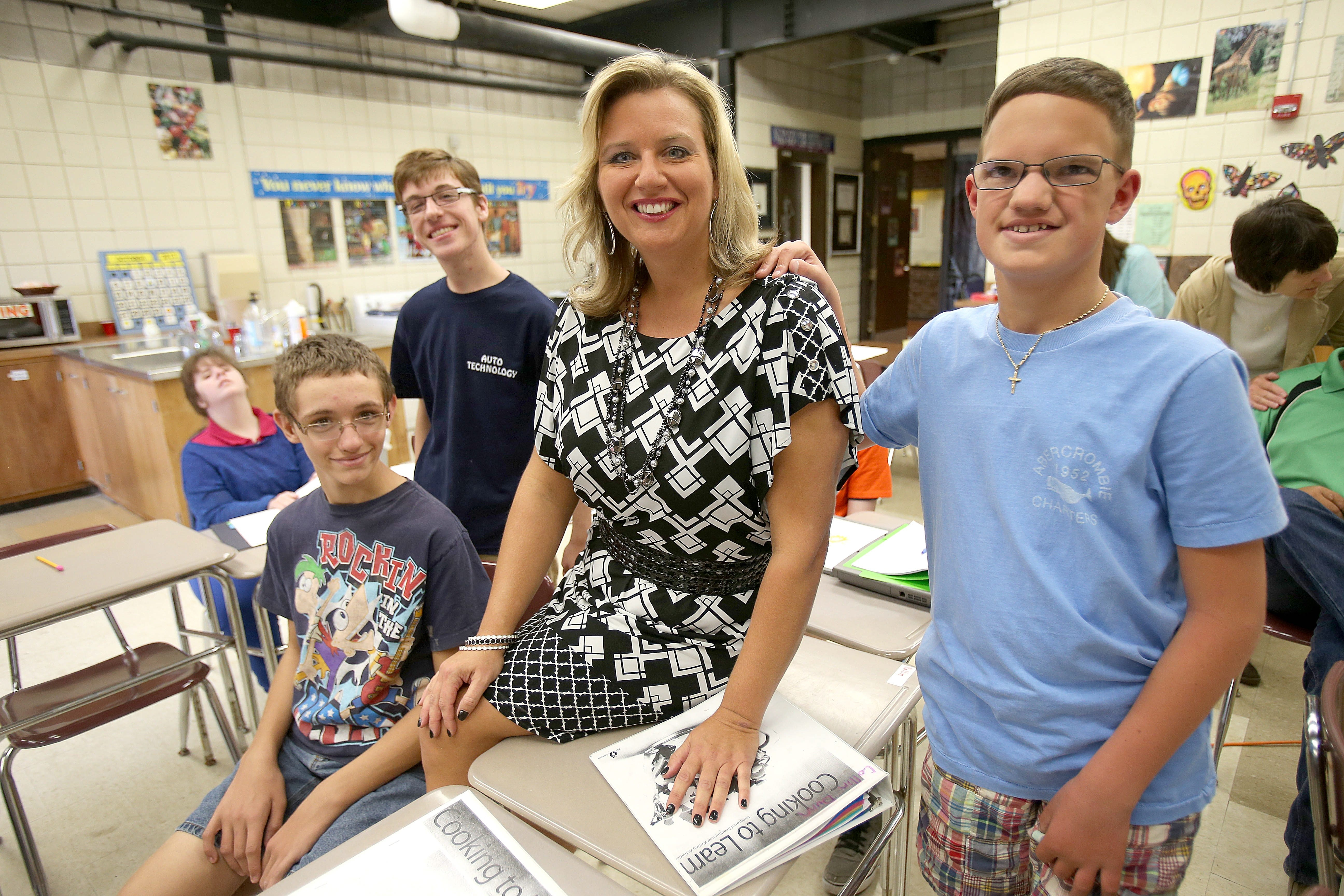 Ashli Skura Dreher, special-education teacher for Lewiston-Porter and State Teacher of the Year, works in high school class with students, from left, Bobby Crewe, 14; Collin Dunn, 19; and Jared Lombardi, 13.