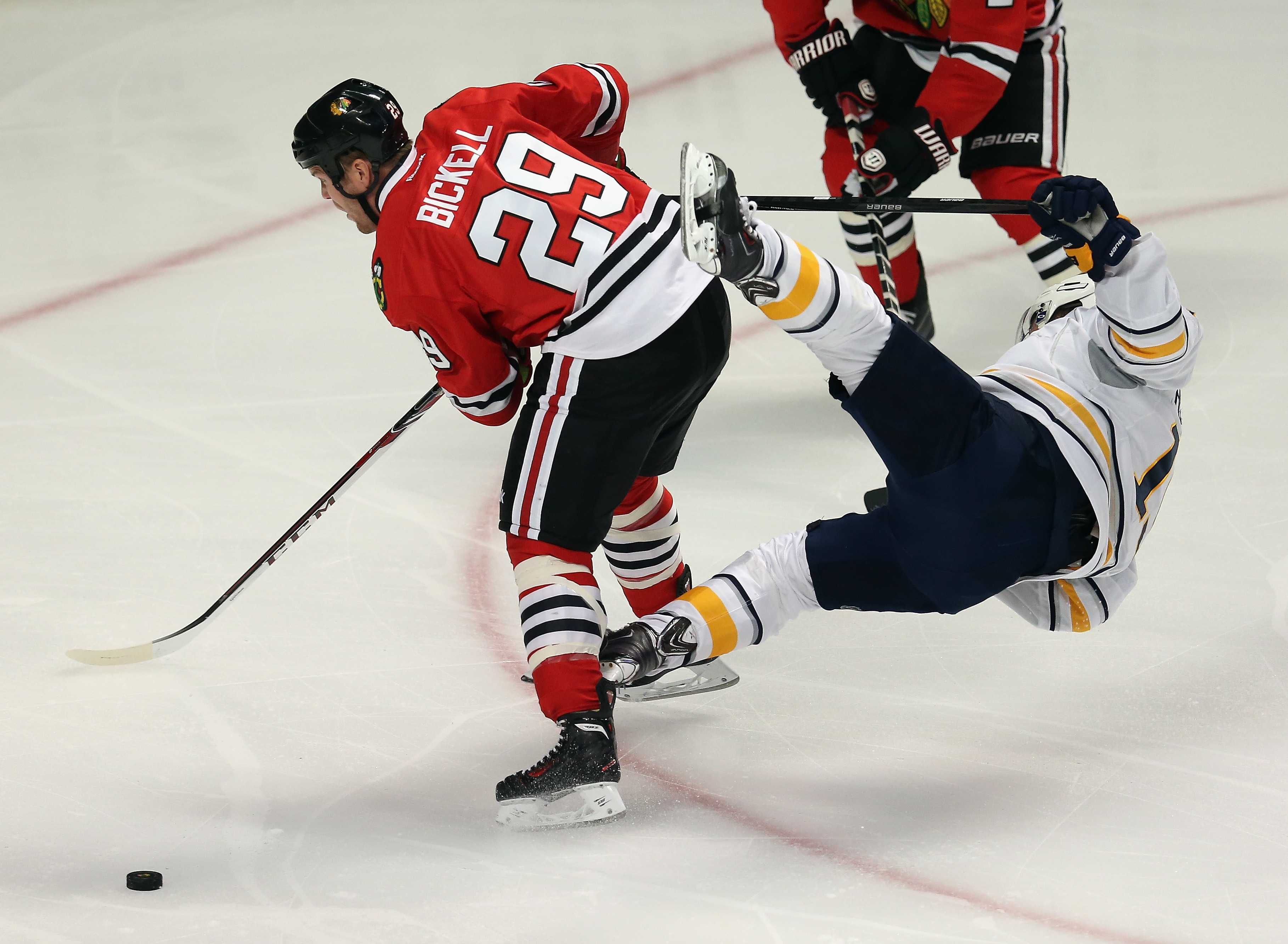CHICAGO, IL – OCTOBER 12: Cody Hodgson #19 of the Buffalo Sabres goes flying in the air after colliding with Bryan Bickell #29 of the Chicago Blackhawks at the United Center on October 12, 2013 in Chicago, Illinois. (Photo by Jonathan Daniel/Getty Images)