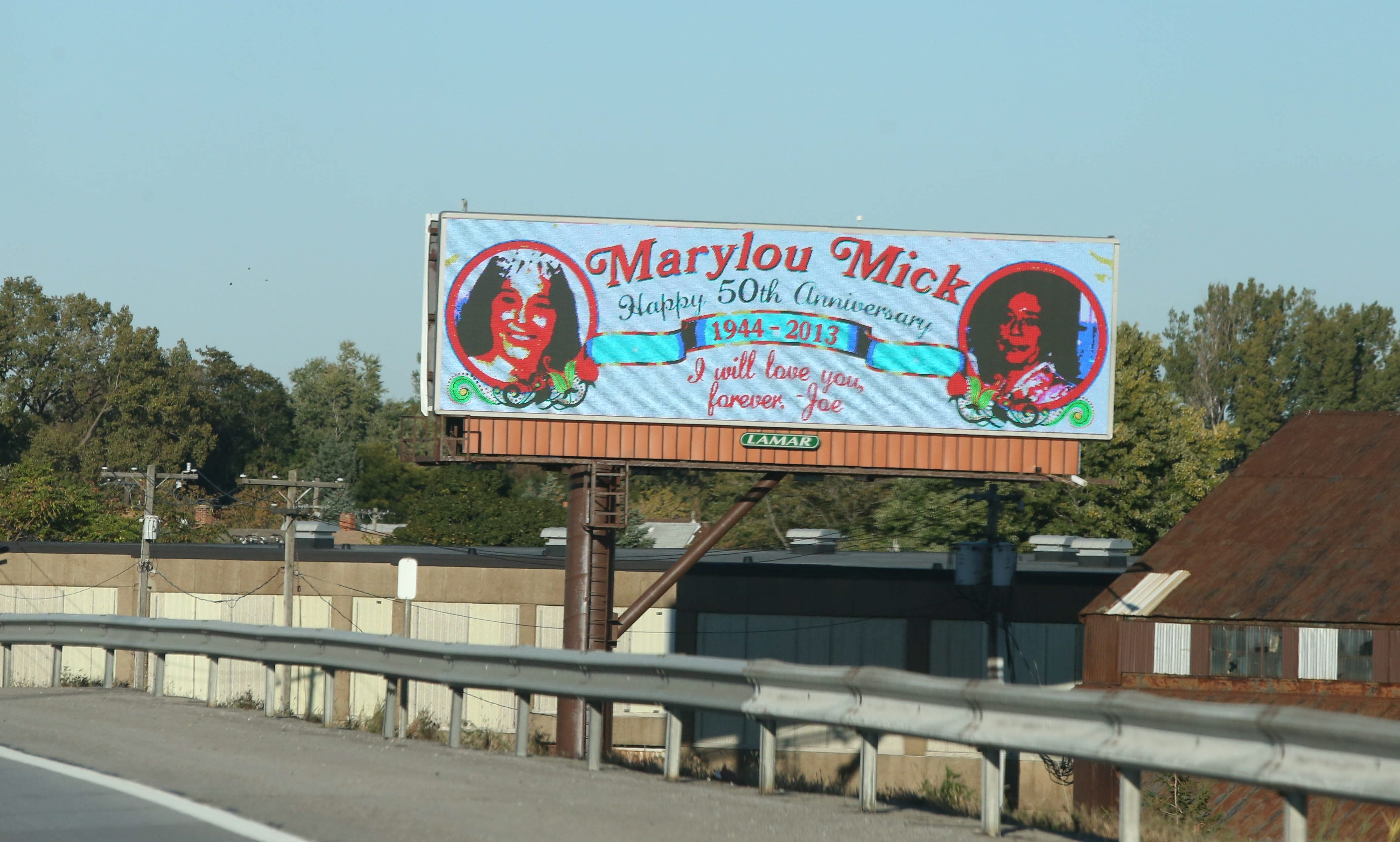 Joseph Mikolajczak's tribute to his late wife, Mary Louise, sits on the southbound I-190, between the Seneca and Clinton street exits.
