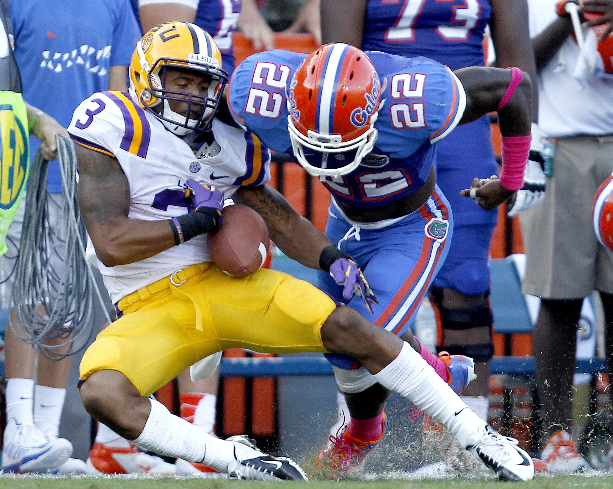 Florida safety Matt Elam forces LSU wide receiver Odell Beckham Jr. to fumble the ball after a long reception during last year's matchup. Beckham is coming off one of the best games of his career in a victory at Mississippi State last weekend. LSU hosts the Gators today.