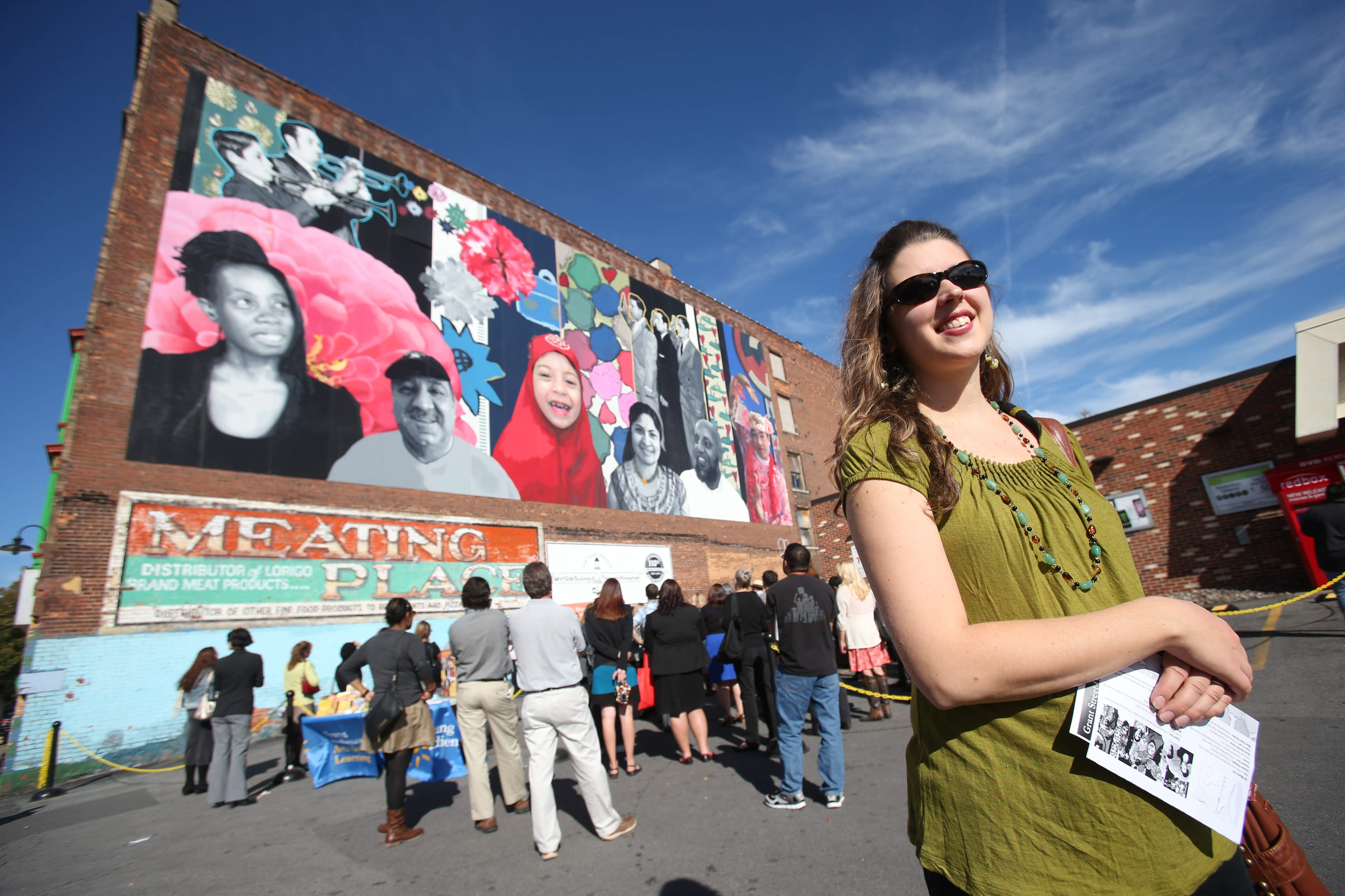 A mural by Augustina Droze, right, and Buffalo Public School students graces the corner at Grant Street and Auburn Avenue.