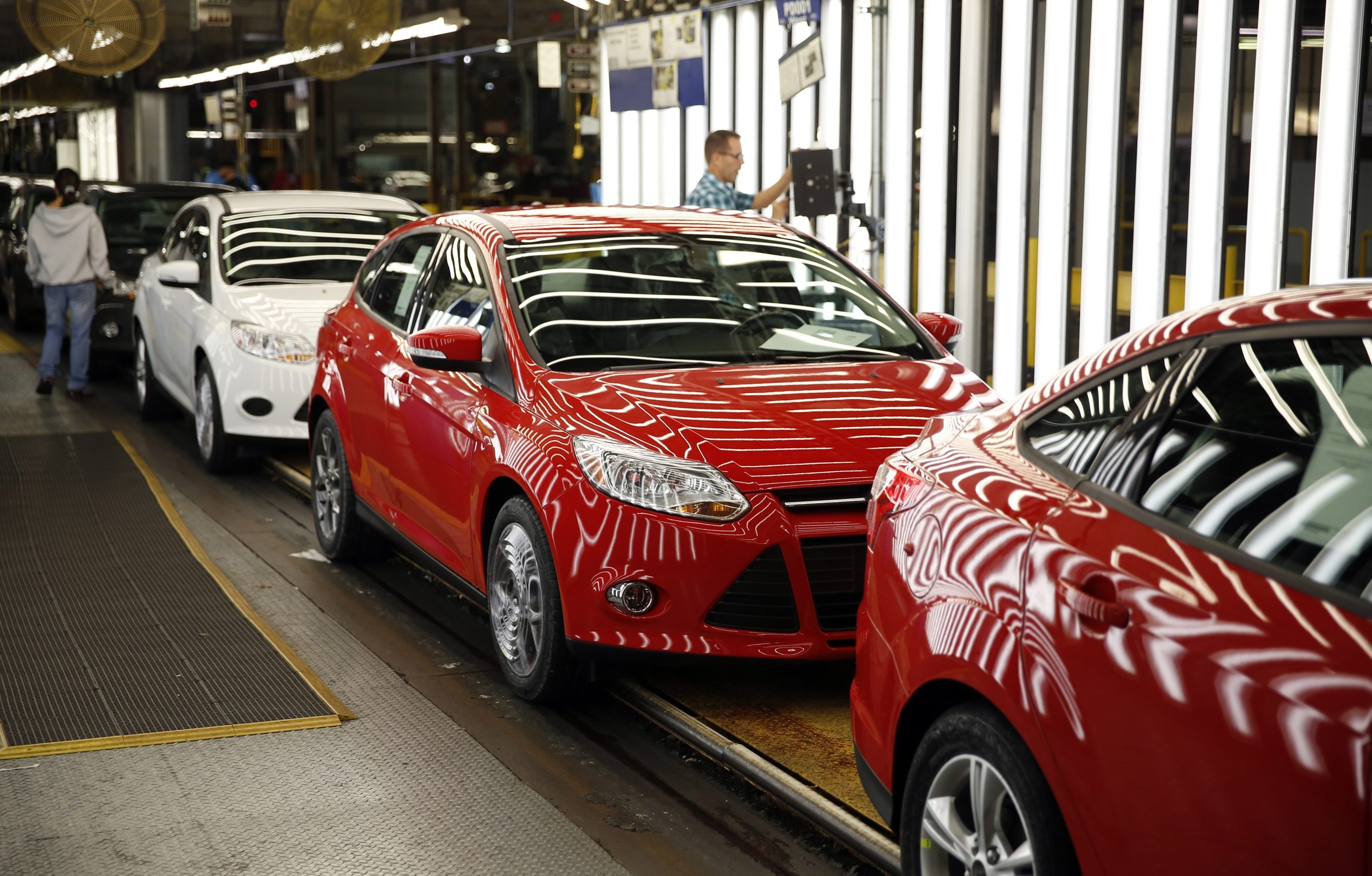 Ford Motor Co. Focus vehicles move through the inspection area at the company's Michigan Assembly Plant in Wayne, Michigan, U.S., on Monday, Oct. 7, 2013. Ford is celebrating the 100th anniversary of the moving assembly line at the plant. Photographer: Jeff Kowalsky/Bloomberg