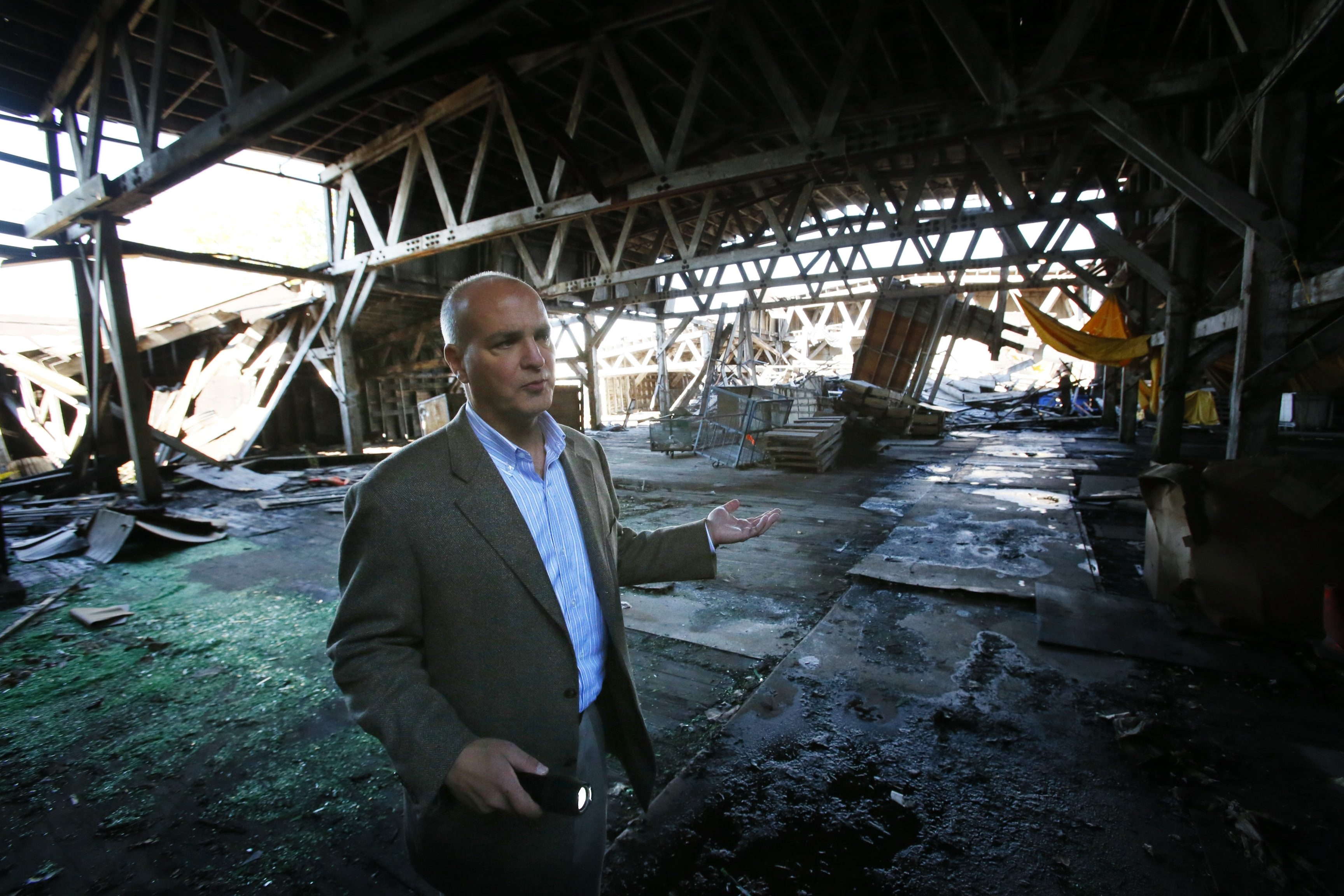 """Savarino Cos. CEO Samuel J. Savarino, who toured the Erie Freight House last year, said the structure's dilapidated condition poses """"a threat to life and safety."""""""