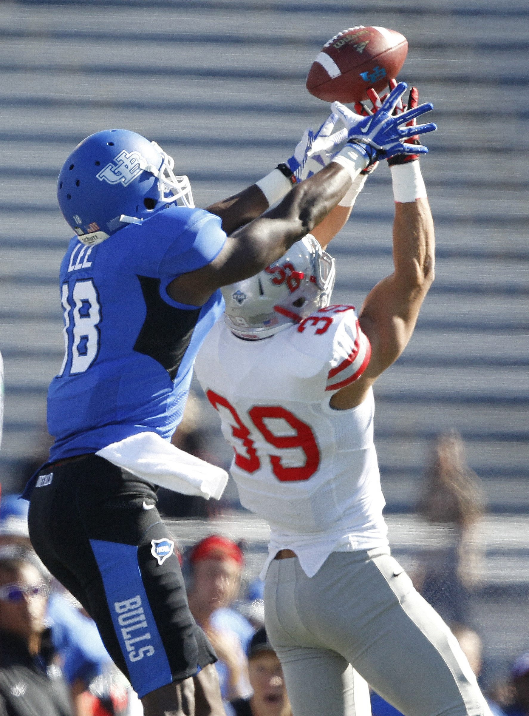 UB player,Fred Lee, battles Stony Brook player, Christian Ricard for a ball in action against Stony Brook ,on Saturday, Sept. 14, 2013. (Harry Scull Jr./Buffalo News)