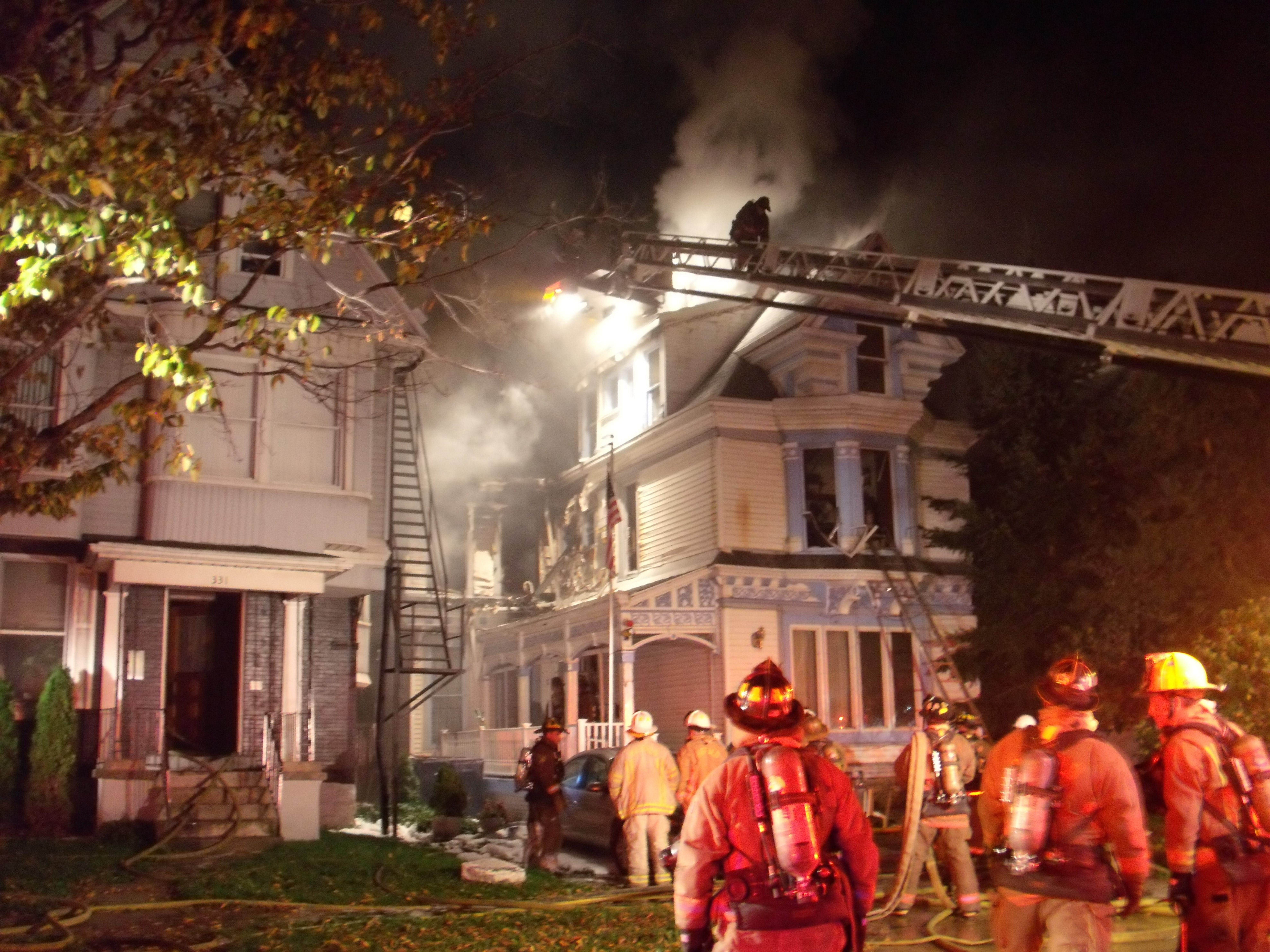 A early-morning fire Thursday damaged this Jersey Street boardinghouse, causing an estimated $300,000 in damages to the structure. Twelve residents were left homeless by the blaze.