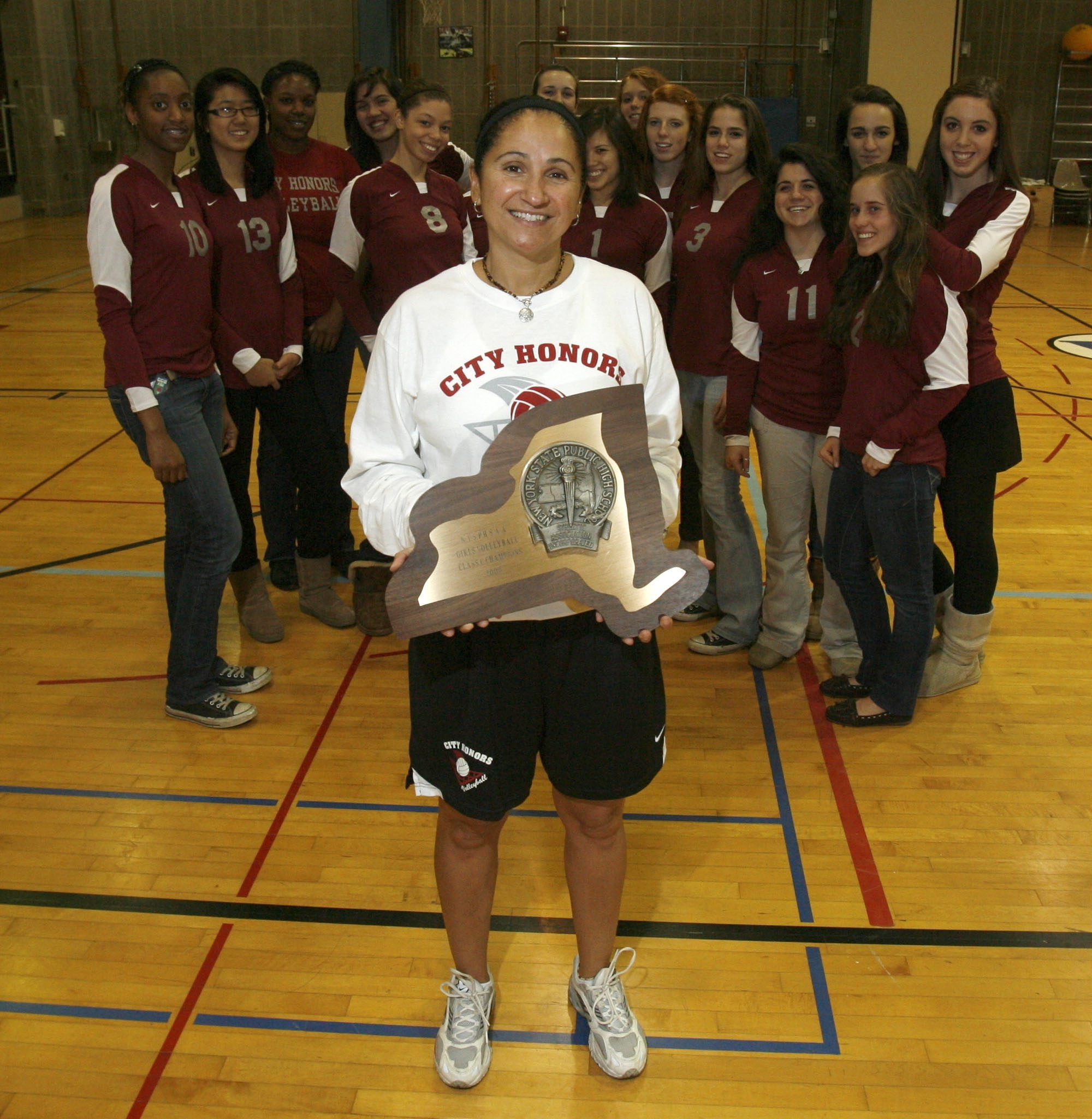 Deb Matos is back coaching volleyball.