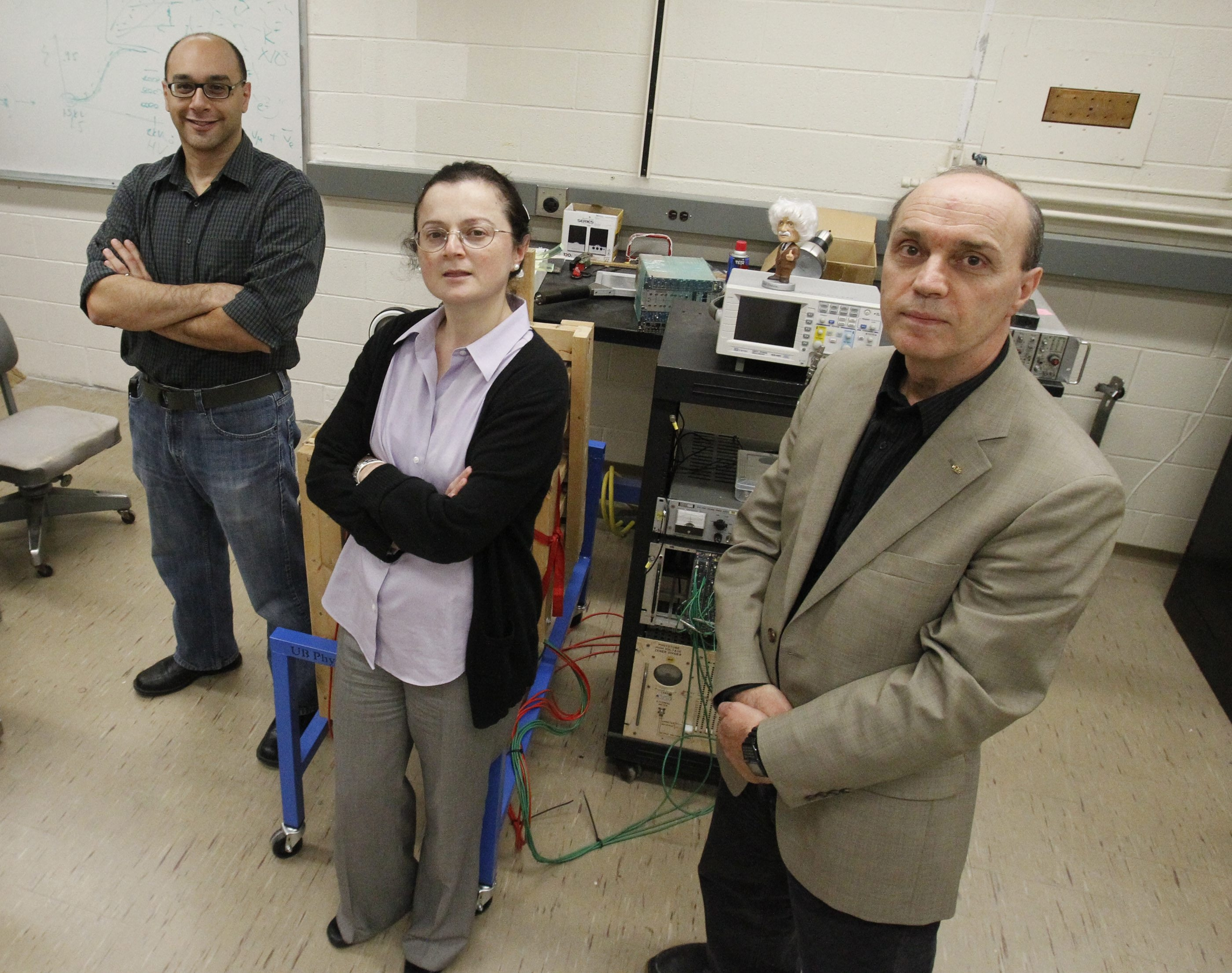 From left, physics professors Salvatore Rappoccio, Ia Iashvili and Avto Kharchilava reflect on the Nobel Prize announcement  in their lab at University at Buffalo on Tuesday.