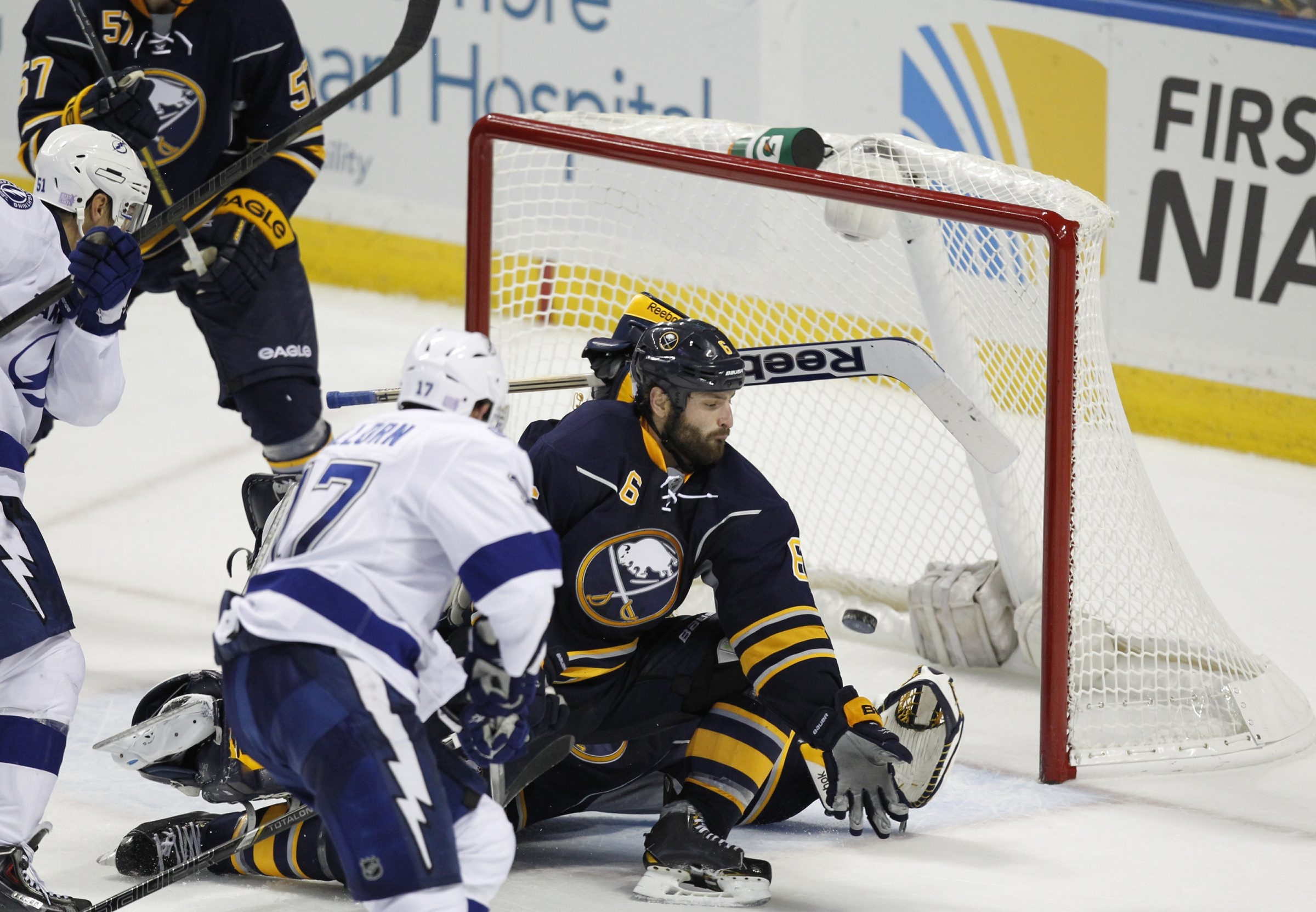 Tampa Bay's Alex Killorn slips the game-winner past Sabres defenseman Mike Weber and screened goalie Jhonas Enroth.