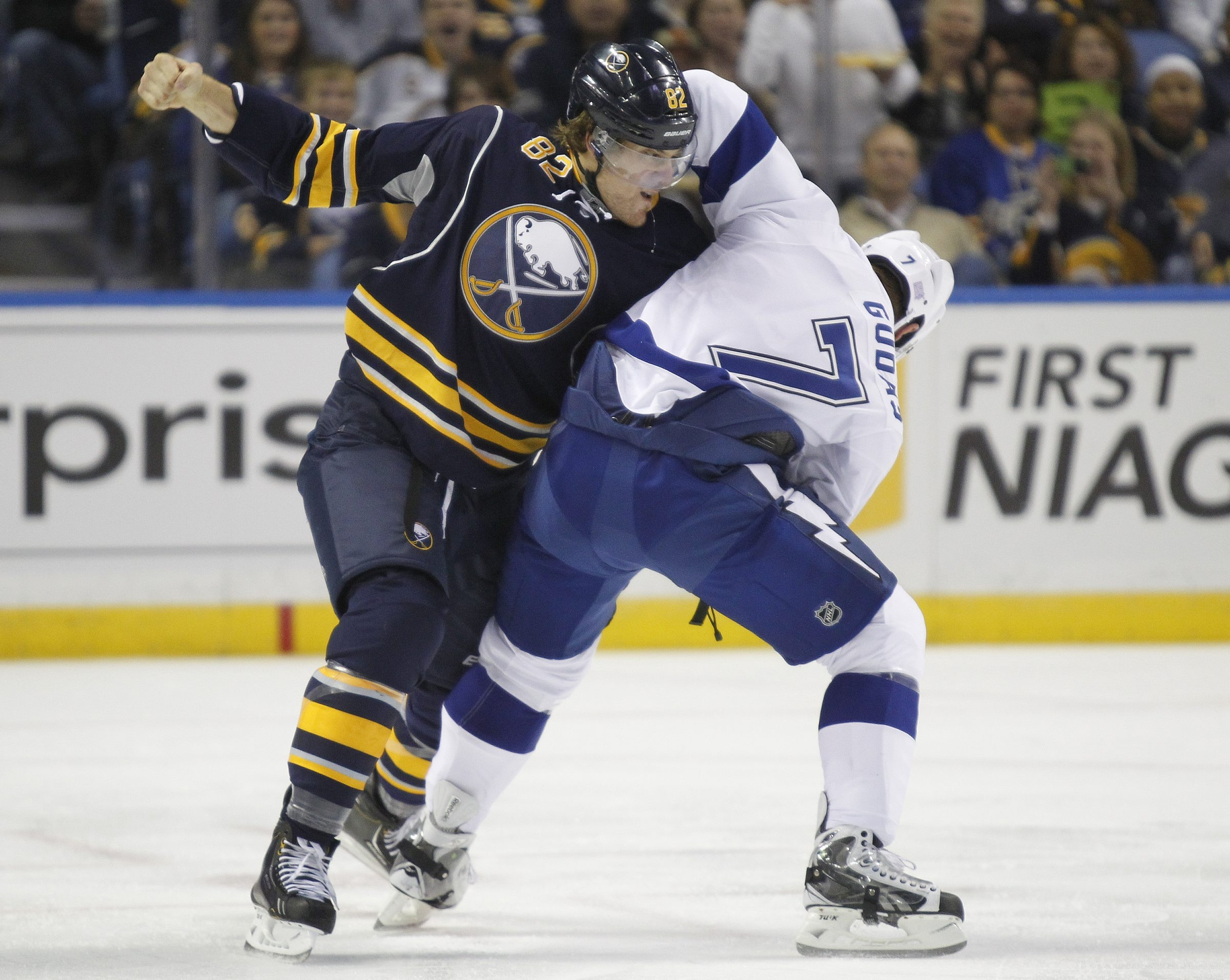 Buffalo's Marcus Foligno and Tampa Bay's Radko Gudas fight early in the first period of Tuesday's game at First Niagara Center.