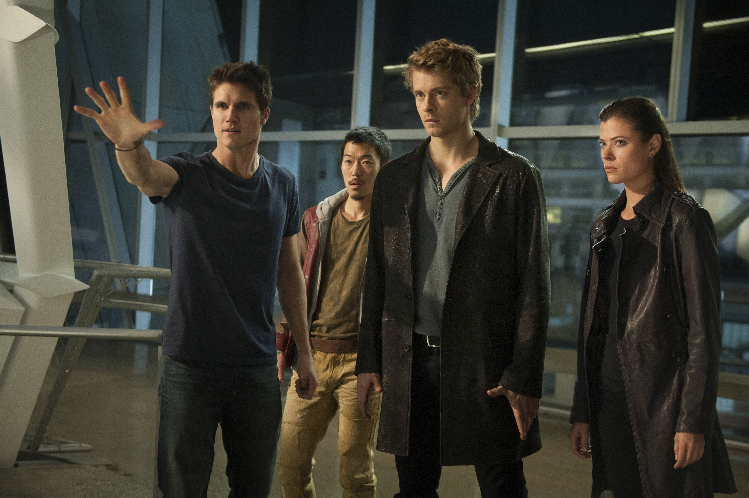 """From left, Robbie Amell as Stephen, Aaron Woo as Russell, Luke Mitchell as John and Peyton List as Cara in a scene from """"The Tomorrow People,"""" premiering at 9 tonight ."""