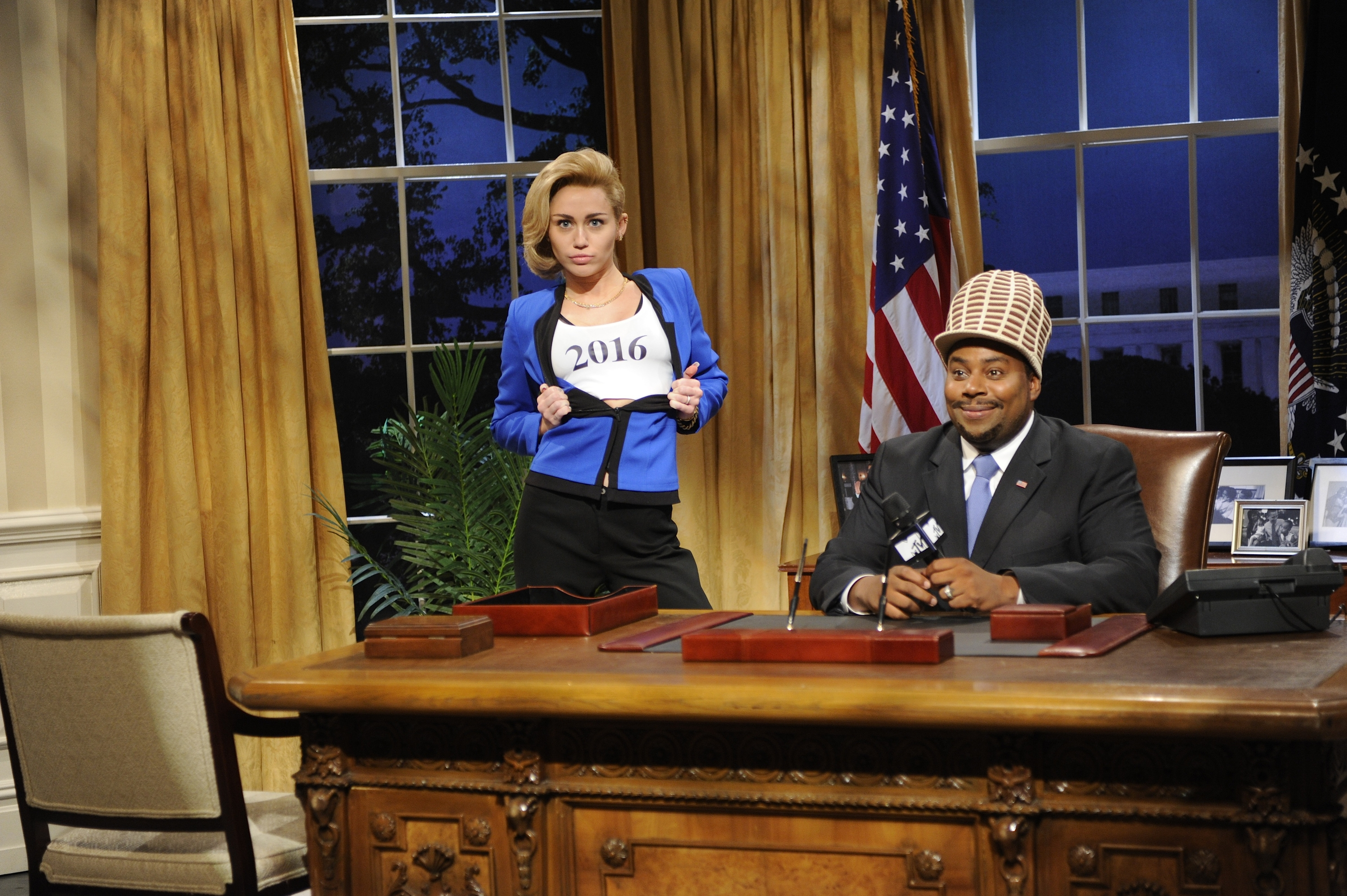 "Guest host Miley Cyrus and Kenan Thompson spoof Washington politics Saturday in a skit on NBC's ""Saturday Night Live"" in New York."
