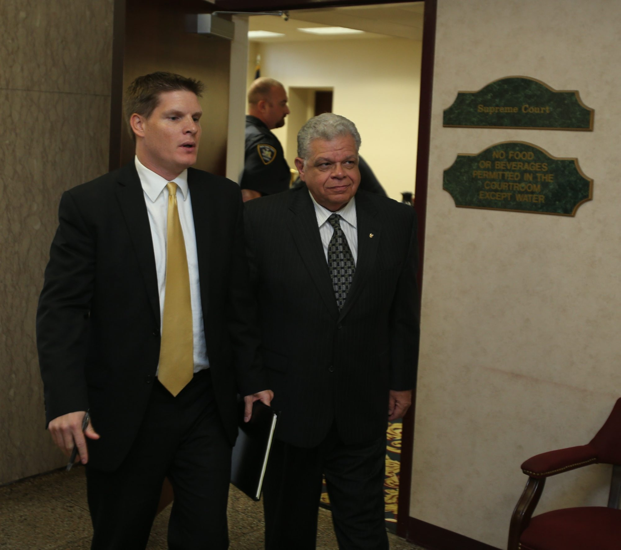 Town of Niagara Supervisor Steven Richards, right, and legal adviser Scott Hapeman leave Niagara County Court in Lockport on Friday following Richards' arraignment.