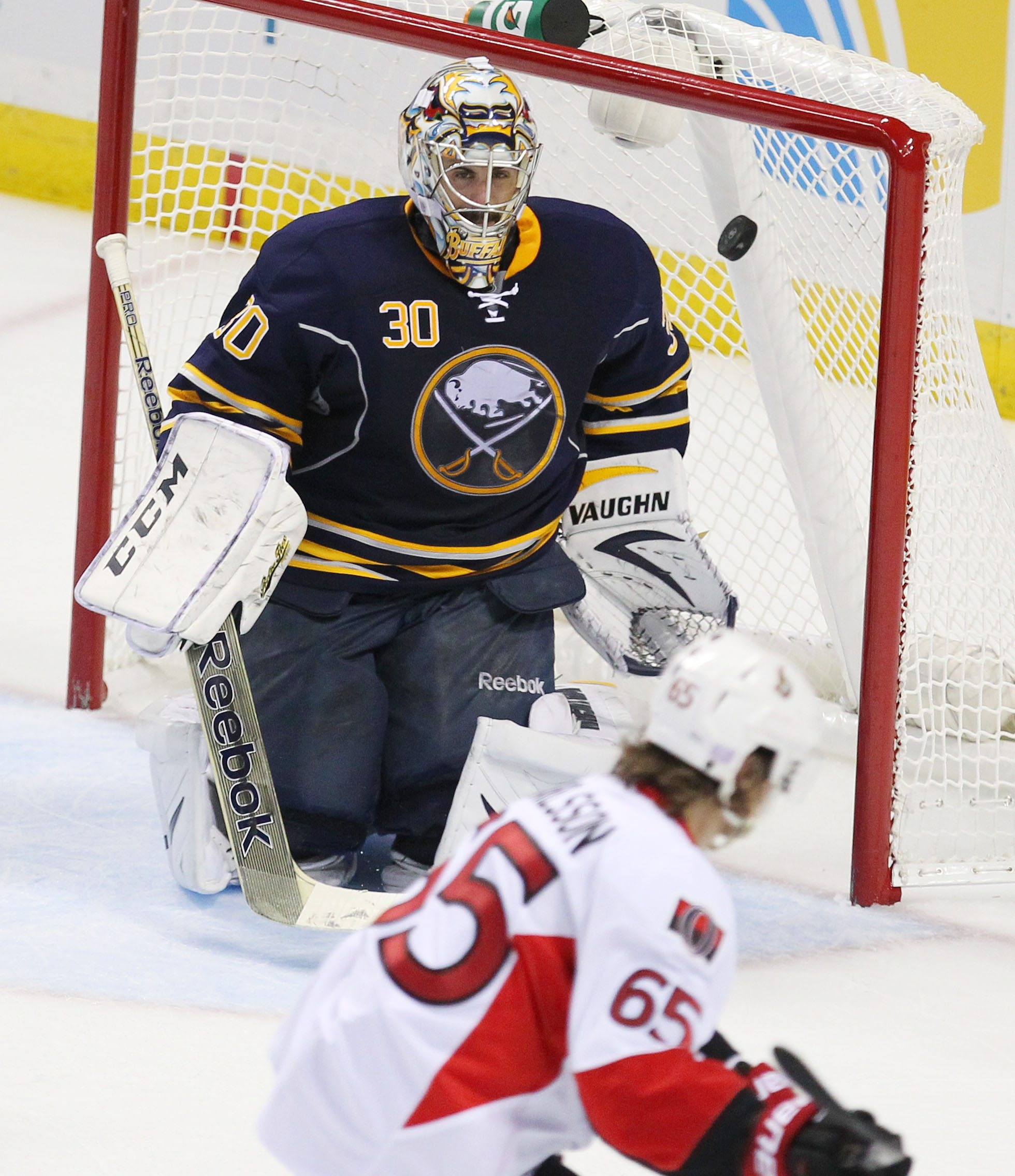 The Senators' Erik Karlsson lifts the game-winning goal past the Sabres' Ryan Miller late in the third period at the First Niagara Center in Buffalo, Friday, October 4, 2013.