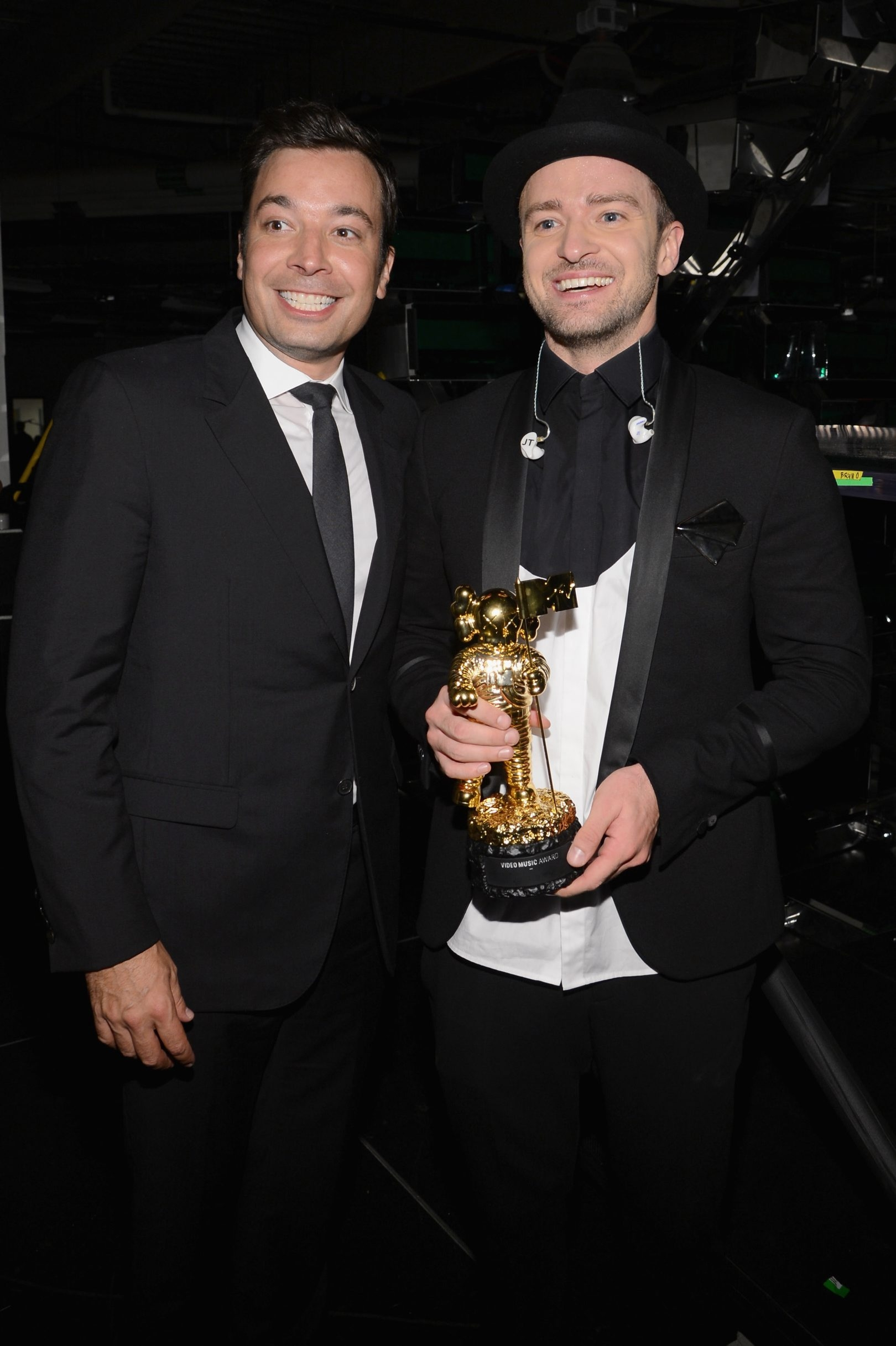"""Justin Timberlake is everywhere these days. At left, he stars with Ben Affleck in """"Runner, Runner,"""" now in theaters. Below, he's seen with pal Jimmy Fallon at the MTV Video Music Awards last month."""