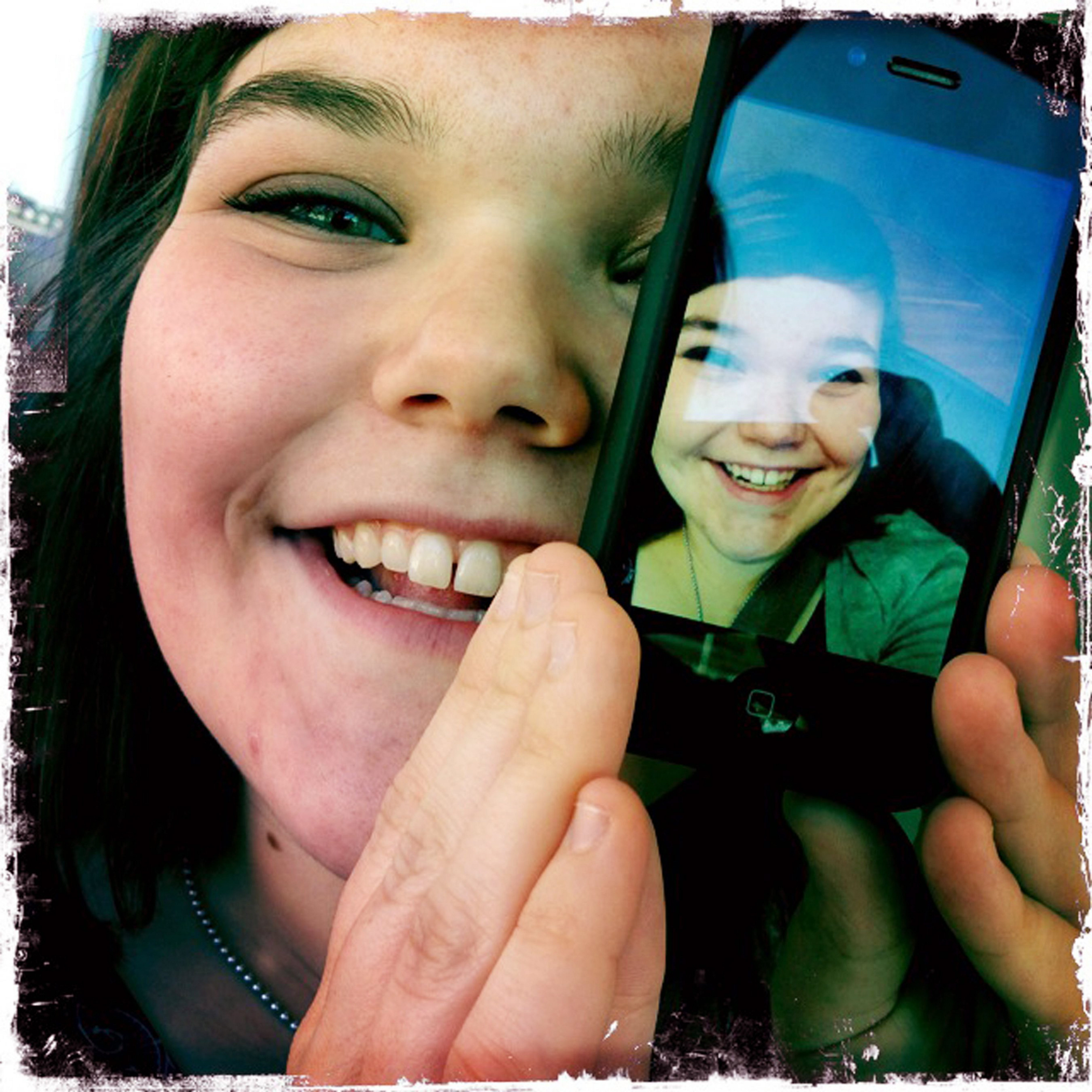 Emma Strub, shown on the University of Minnesota campus in Minneapolis, enjoys taking self-portraits, or selfies, with her cellphone and sharing them with friends.