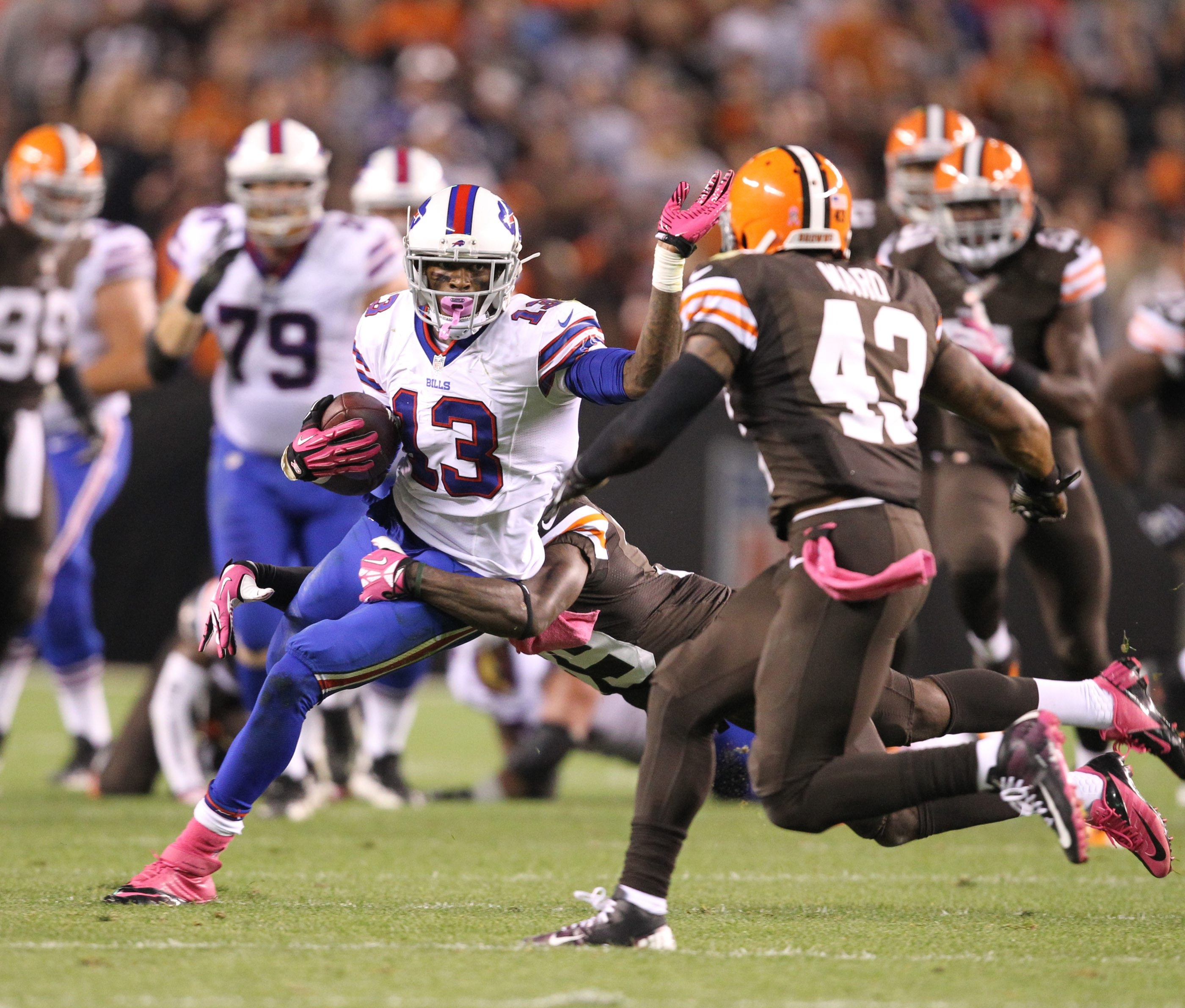 Bills wide receiver Stevie Johnson tries to break the tackle of Browns safety Tashaun Gipson.