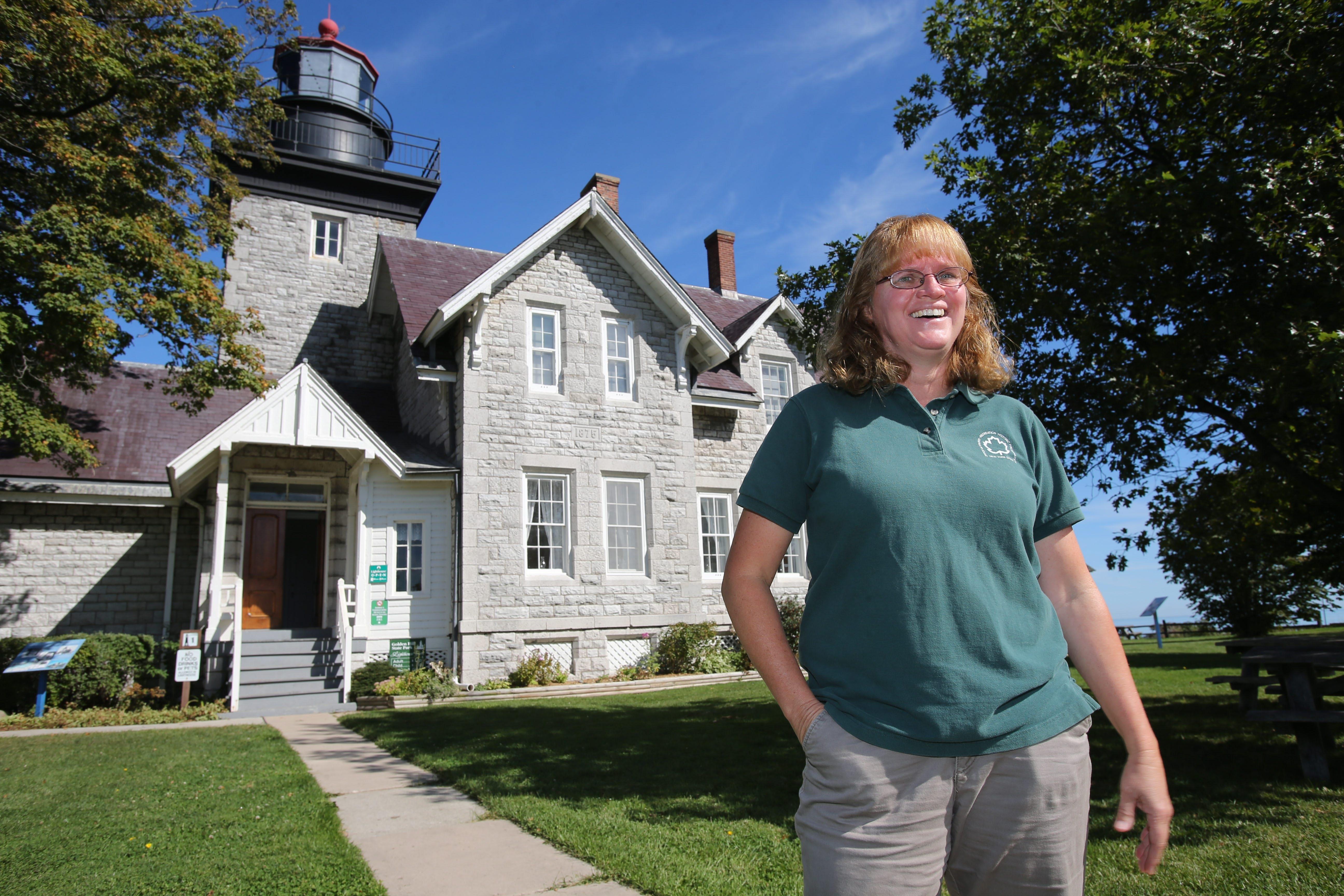 Barbara Larson, President of Friends of the Lighthouse, outside of the 30 Mile Pt. Lighthouse in Golden Hill State Park in Barker, Thursday, September 26, 2013.  (Charles Lewis/Buffalo News)