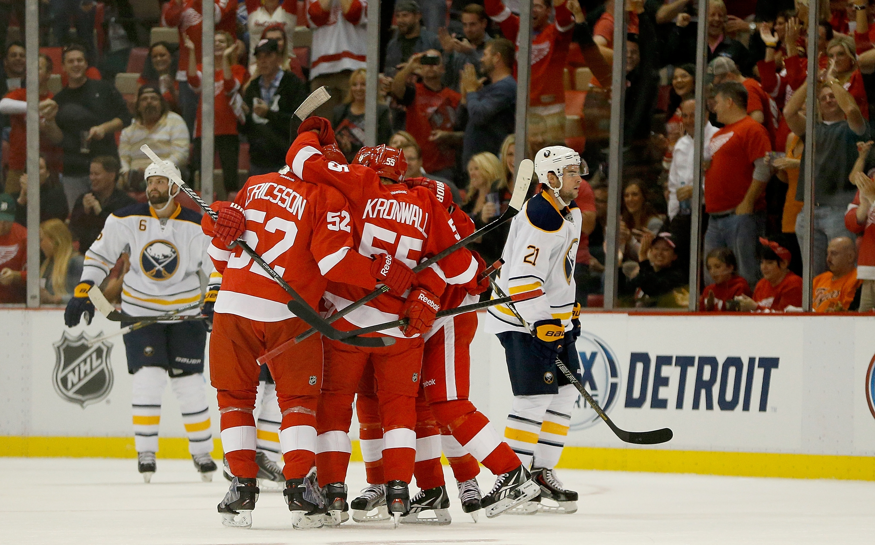Detroit's Jonathan Ericsson and Niklas Kronwall celebrate Pavel Datsyuk's first-period goal in front of Buffalo's Drew Stafford (21).
